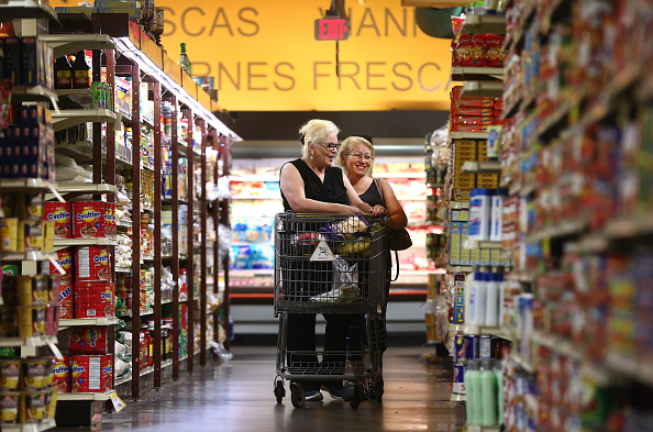 BOSTON, MA - AUGUST 22: Sisters Cruz Sanchez, left, of Mattapan, and Frances Rosado, of Dorchester, shop at Tropical Foods in the Roxbury neighborhood of Boston on Aug. 22, 2017. The locally owned store caters to a mostly immigrant and largely low-income population. Through the experience of Tropical Foods, online shopping and home delivery will be a tough sell to some low-income shoppers. The store estimates 70 percent of its customers pay with food stamps, and it sources some items from Africa and South America. (Photo by Pat Greenhouse/The Boston Globe via Getty Images)