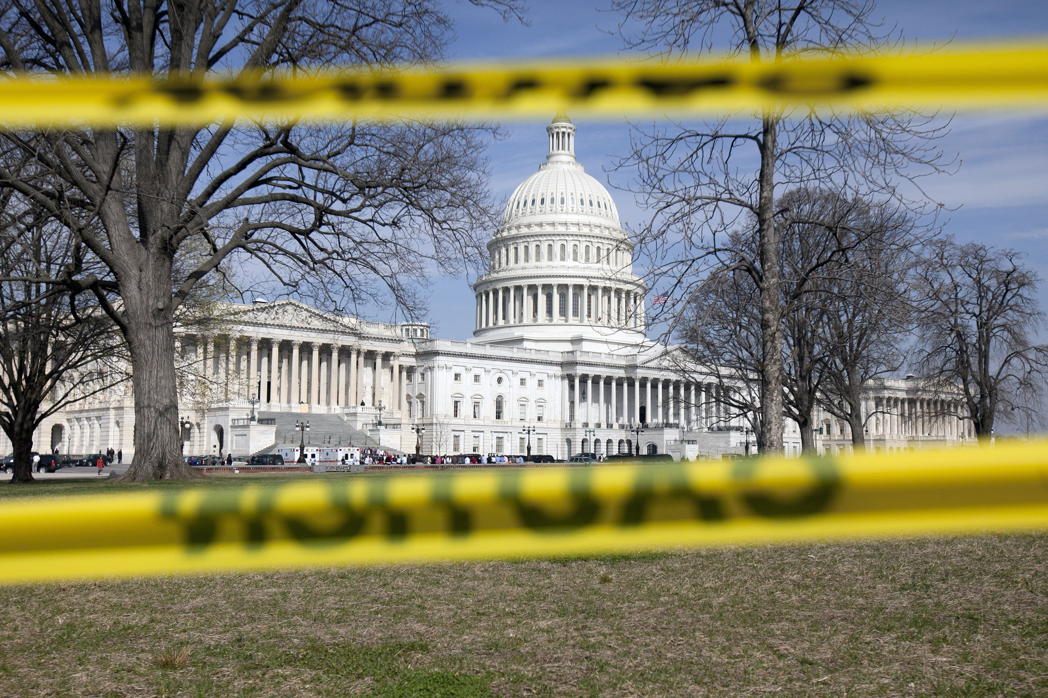The Capitol building stands behind caution tape
