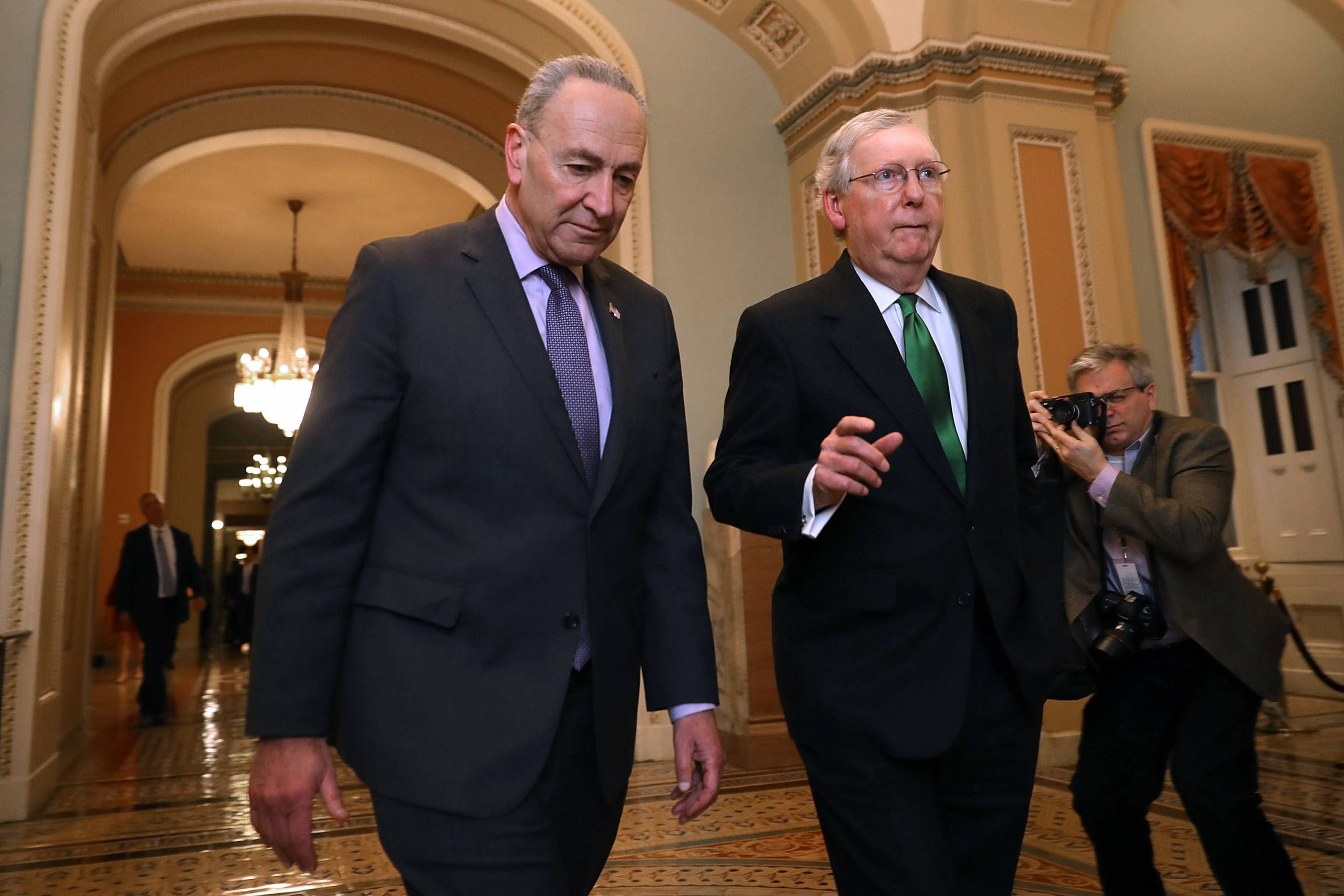 Senate Majority Leader McConnell (R-KY) And Senate Minority Leader Schumer (D-NY) Walk To Senate Chamber Together After Budget Deal Reached