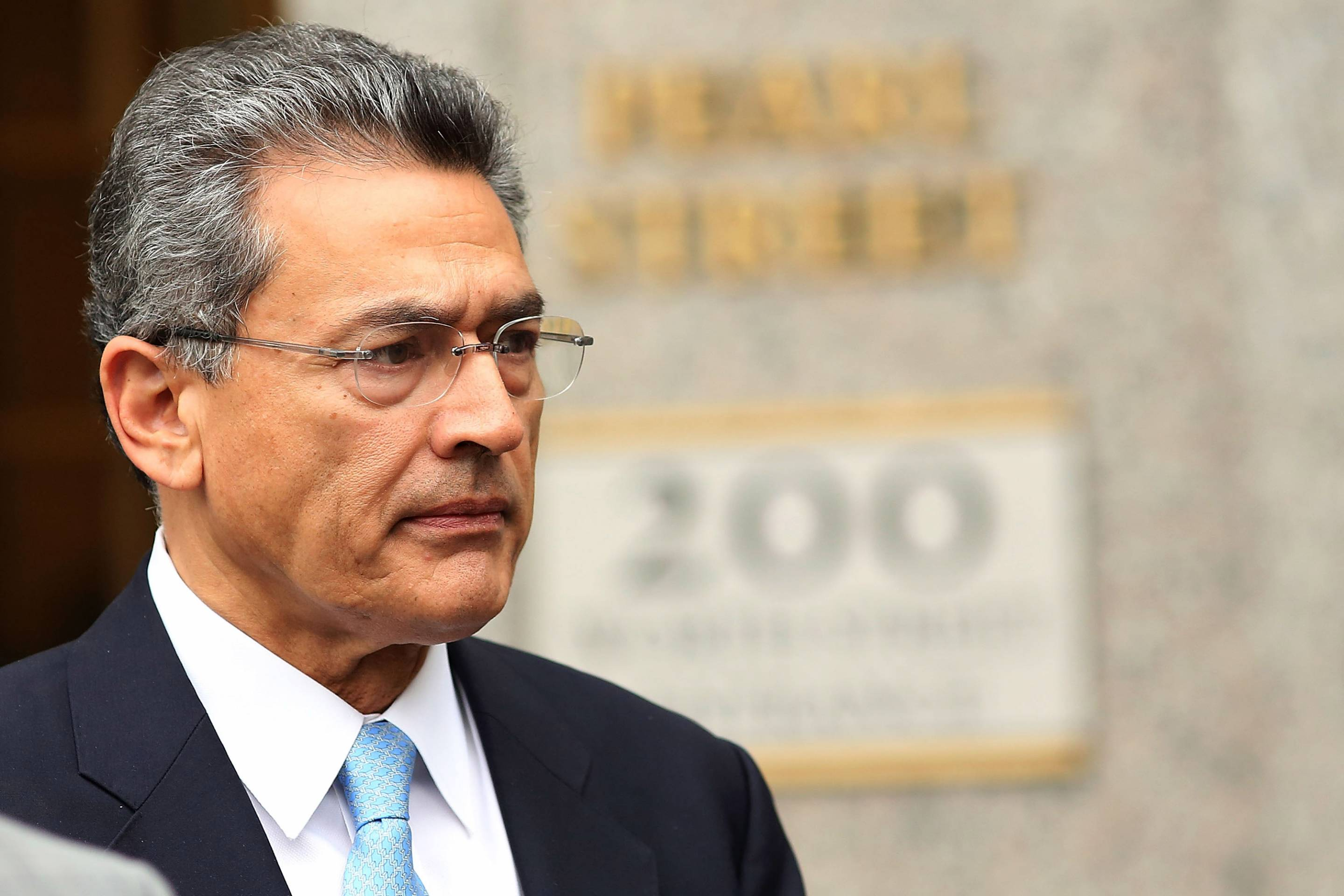 Rajat Gupta, former managing director at McKinsey, exits federal court after being sentenced to two years in prison on Oct. 24, 2012, in New York City.