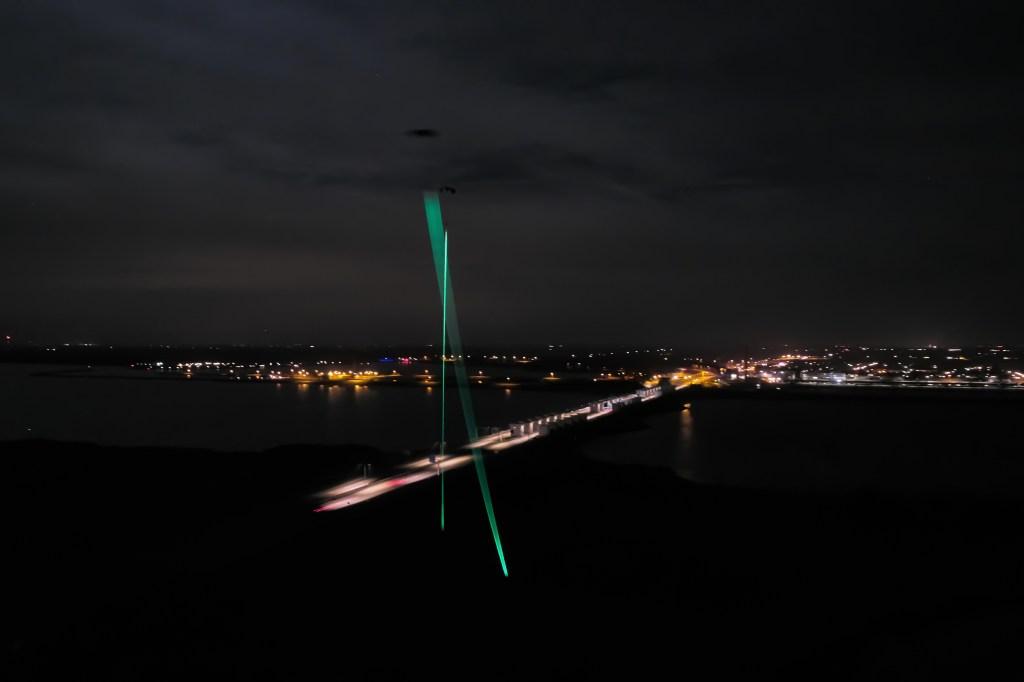 "Glowing lines tether kites to dynamo generators in Studio Roosegarde's ""Windvogel."""