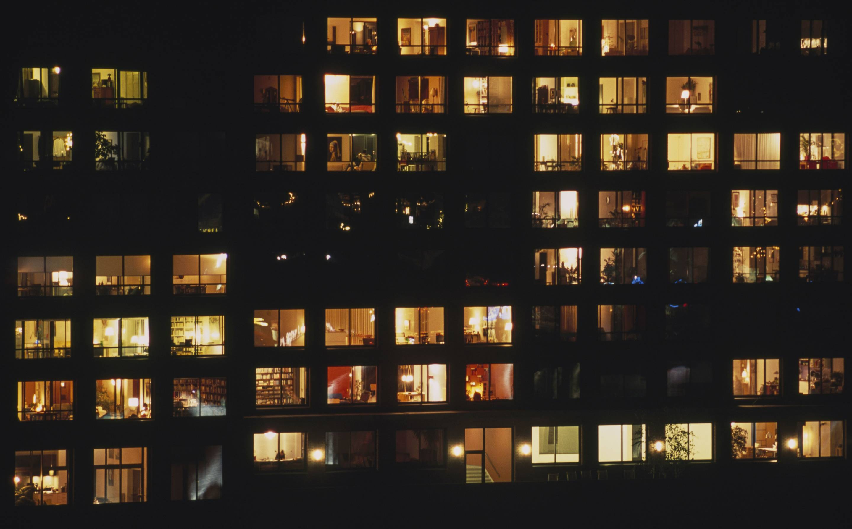 Building in Java-eiland neighborhood, at night, with illuminated windows, Amsterdam, Netherlands