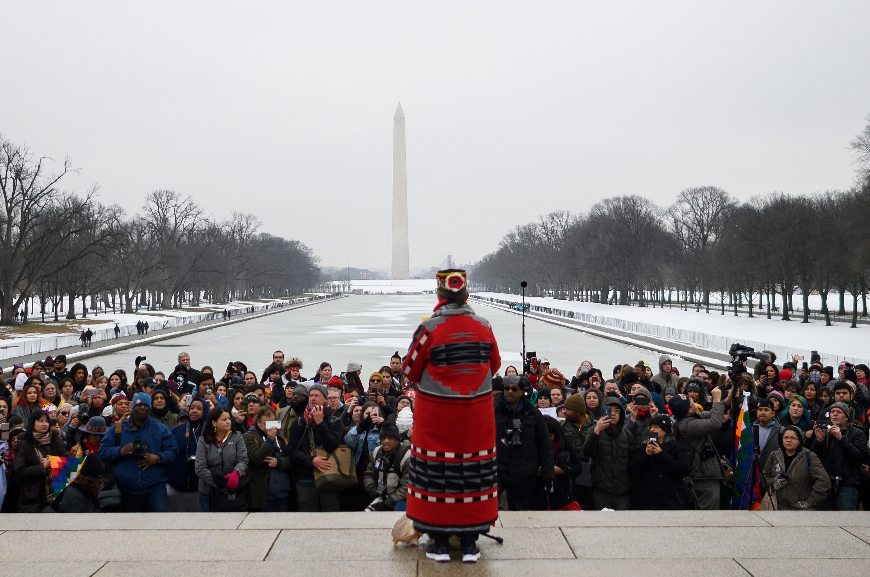 A woman speaks during the Indigenous People's March on the National Mall at the Lincoln Memorial in Washington, DC, on January 18, 2019.