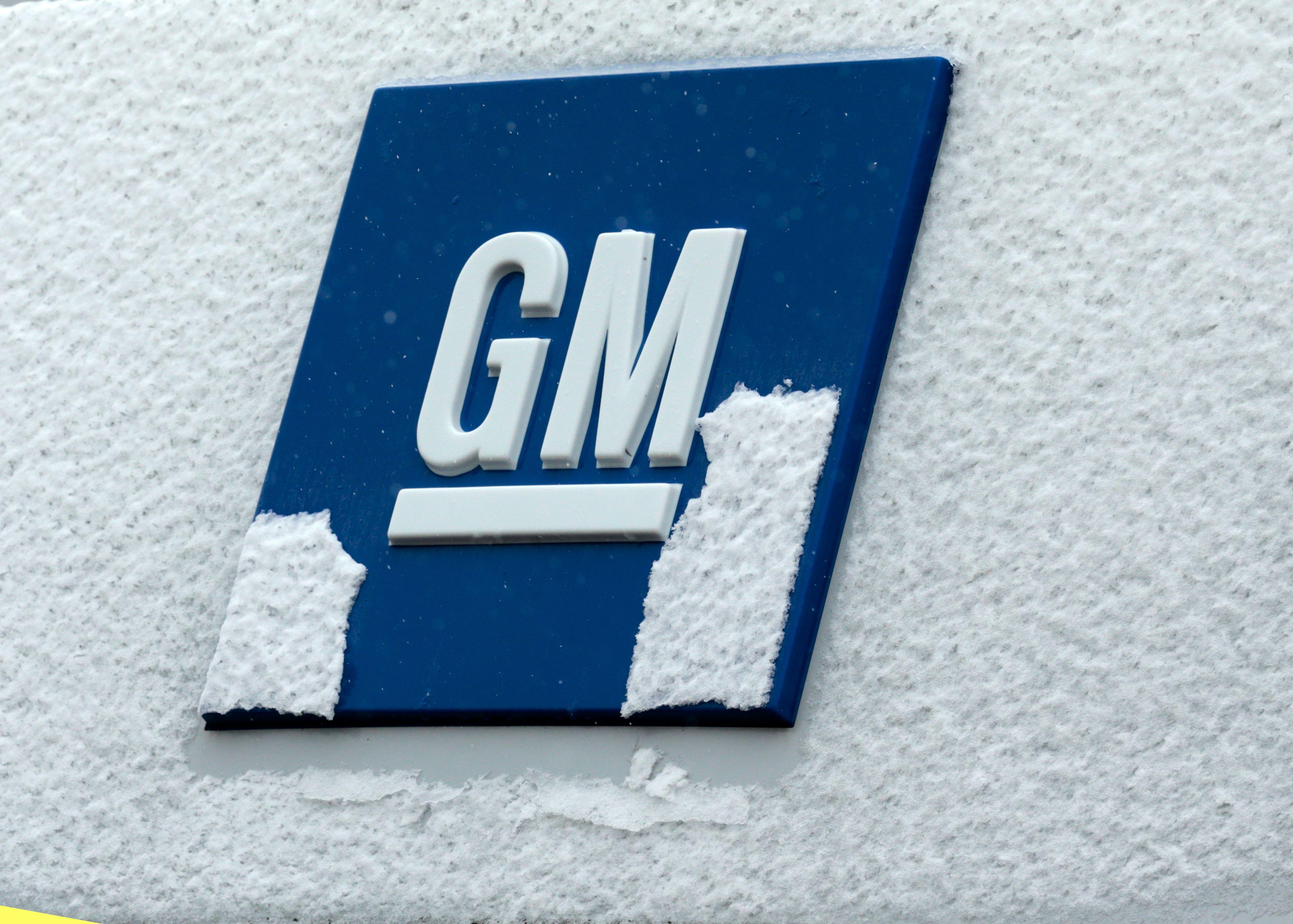 General Motors logo covered in snow.