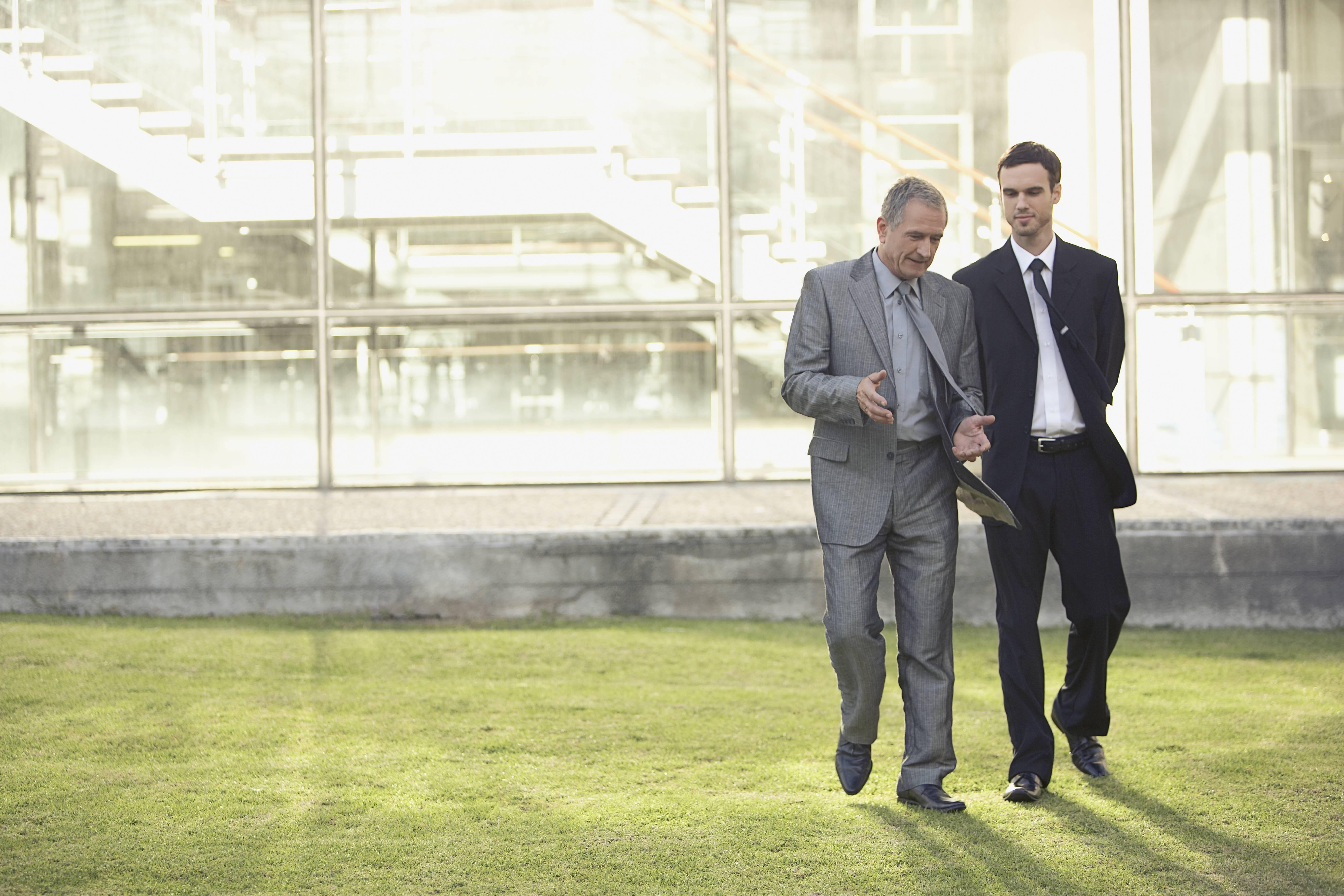 Financial advisors walking outside
