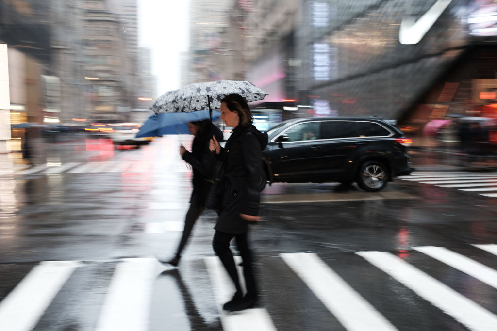 Cold Rain And Wind Bear Down On New York City Commuters
