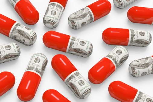 Pills decorated with dollar bills