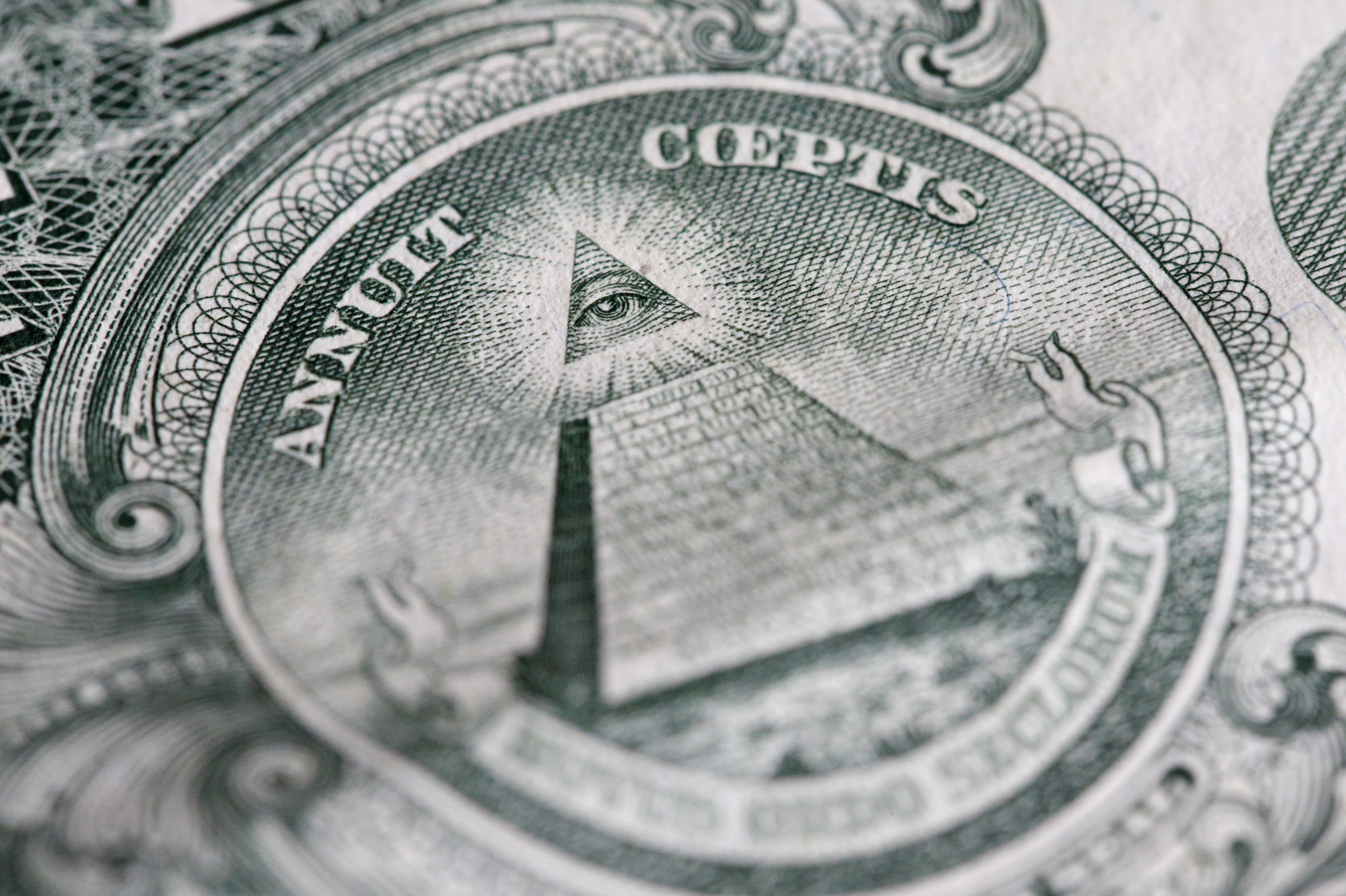 The reverse of the United States one-dollar bill depicting a Pyramid with 13 steps and the Eye of Providence.