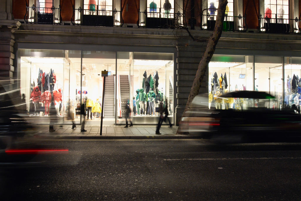 Shop front at night, Oxford Street, London, UK
