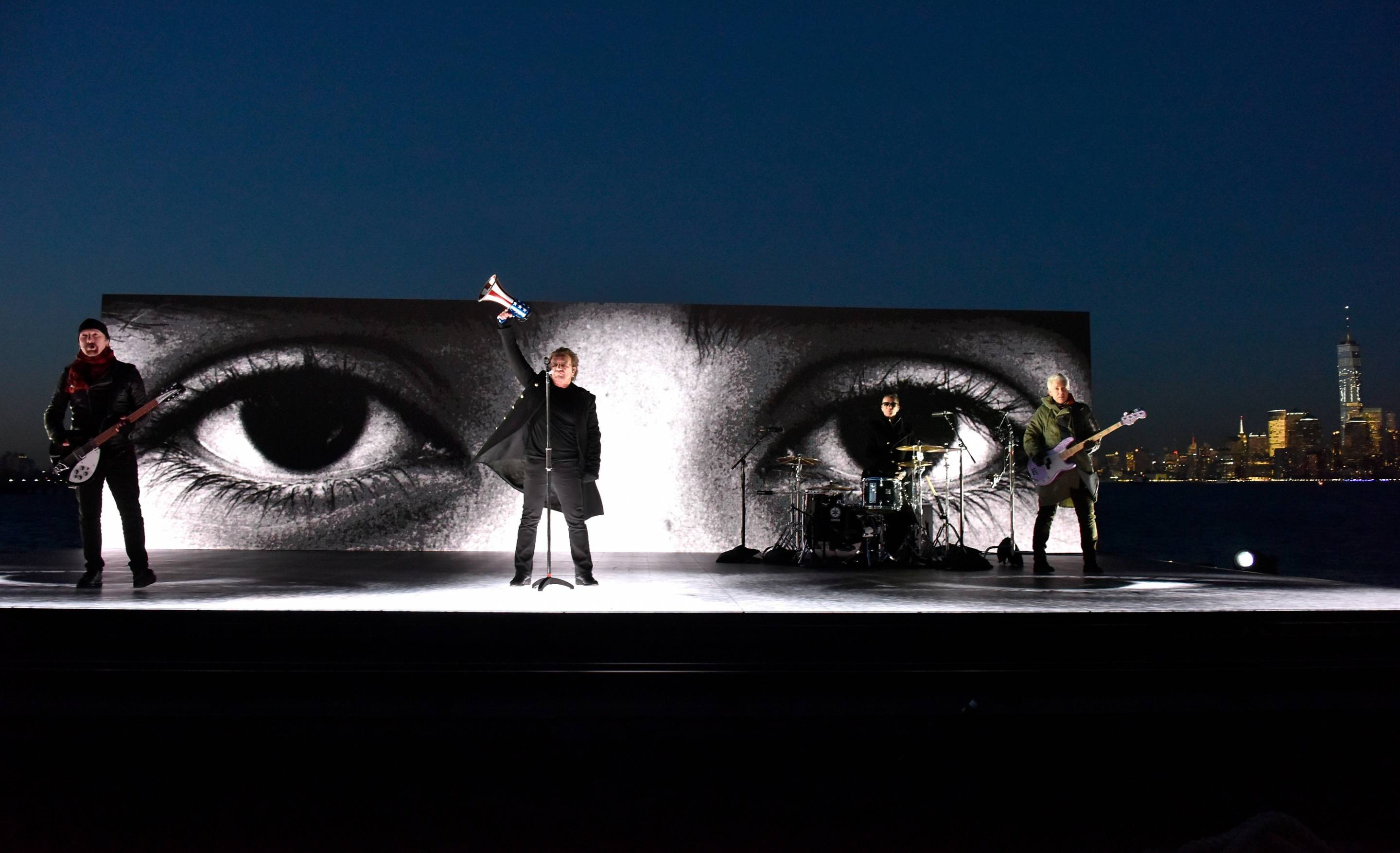 U2 makes a pro-immigration statement while performing on a barge during the 60th Annual Grammy Awards on Jan. 28, 2018, in New York City.
