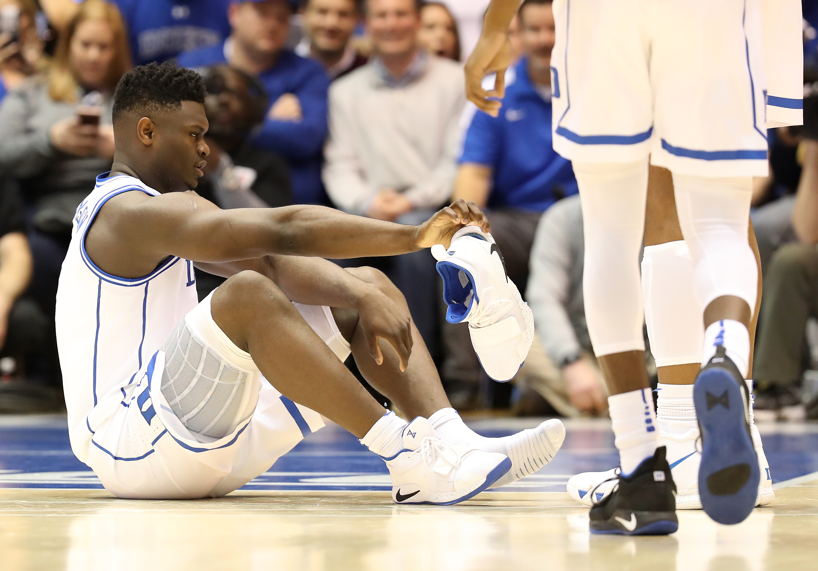 Duke's Zion Williamson reacts after his shoe breaks during a game on Feb. 20, 2019, in Durham, N.C.
