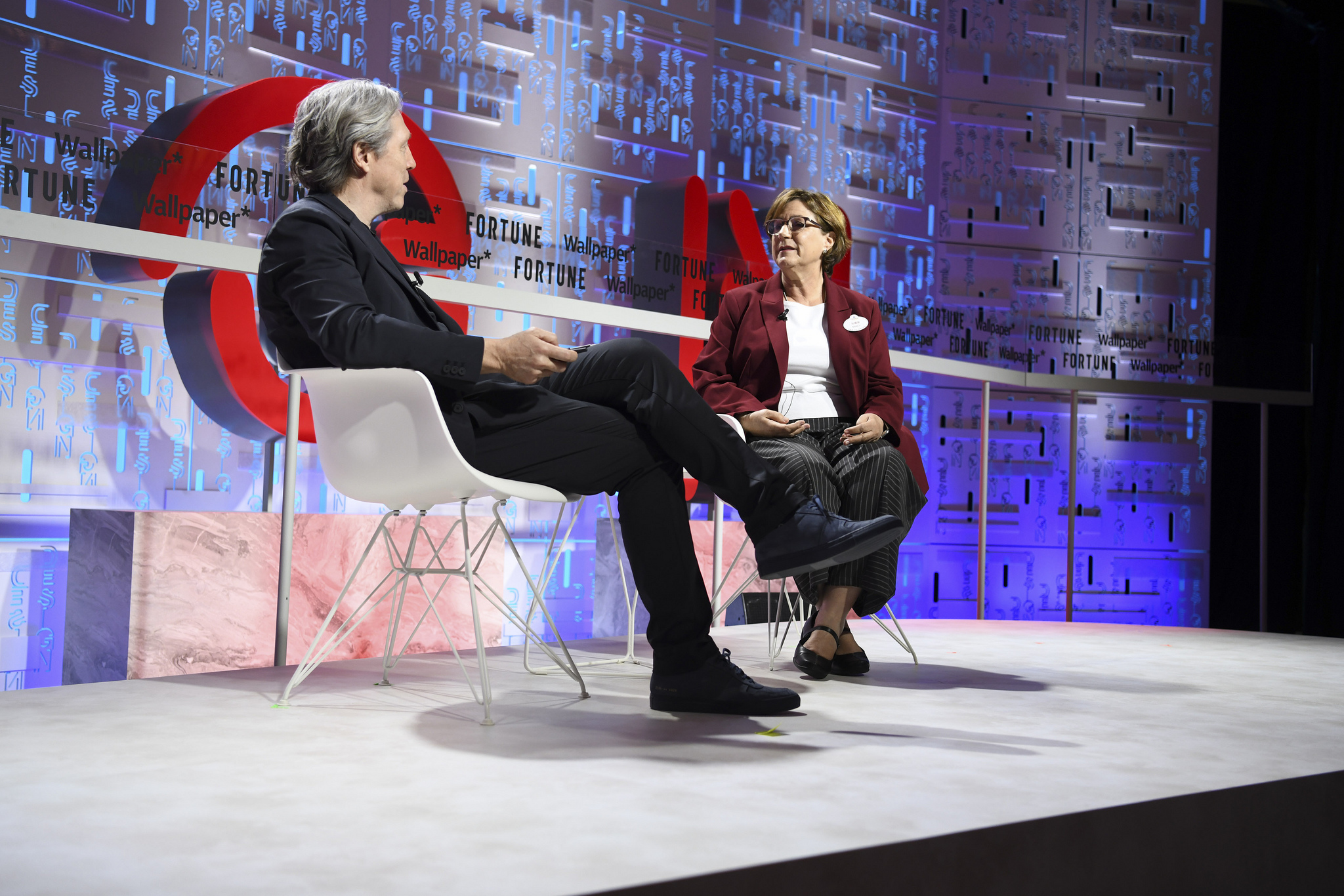 Nancy Seruto (right), executive producer for Walt Disney Imagineering, with Fortune's Clay Chandler at the 2019 Fortune Brainstorm Design conference in Singapore.