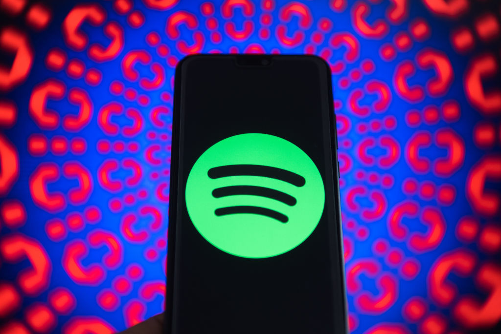 Spotify logo is seen on a mobile phone