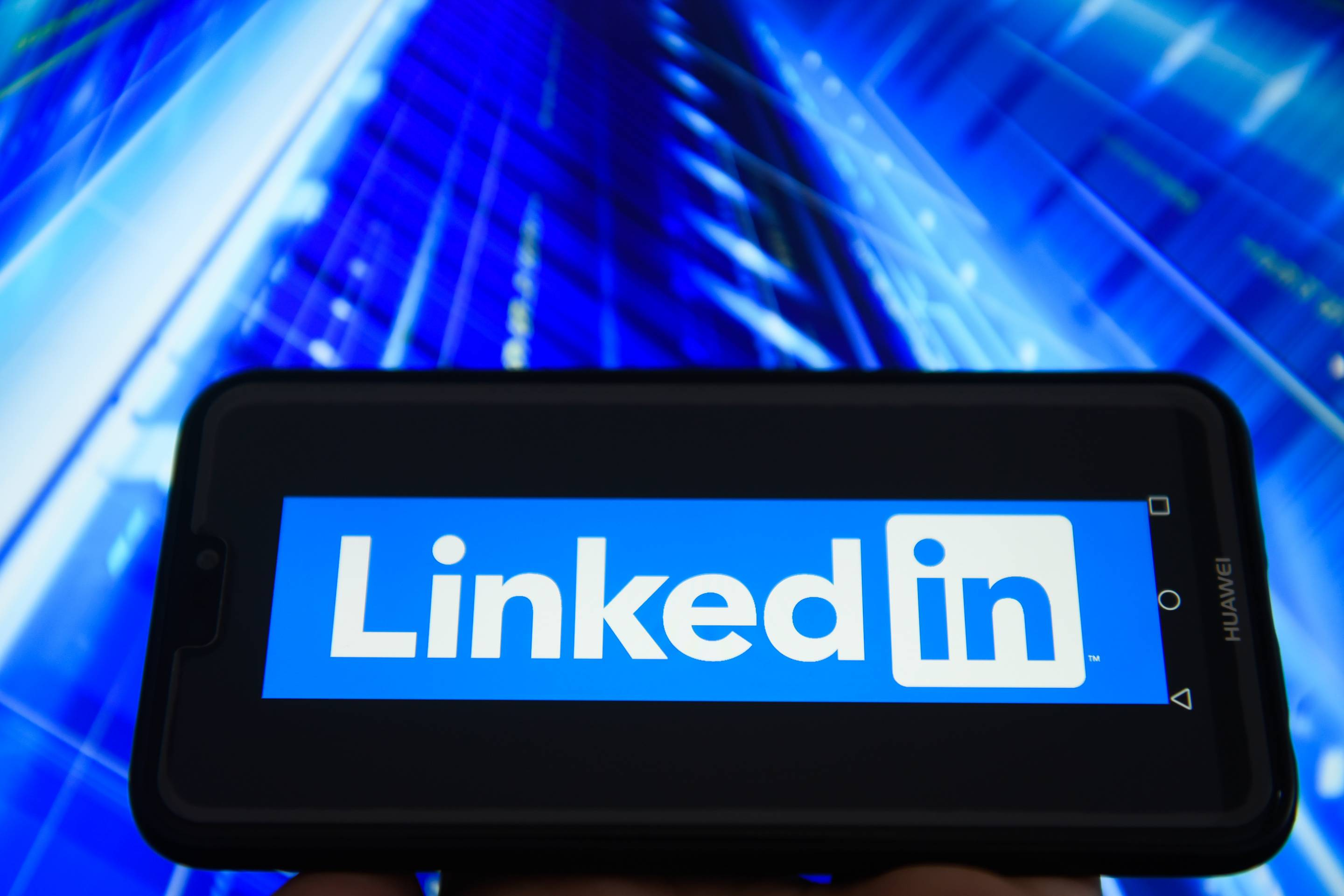 LinkedIn logo is seen on an Android mobile device
