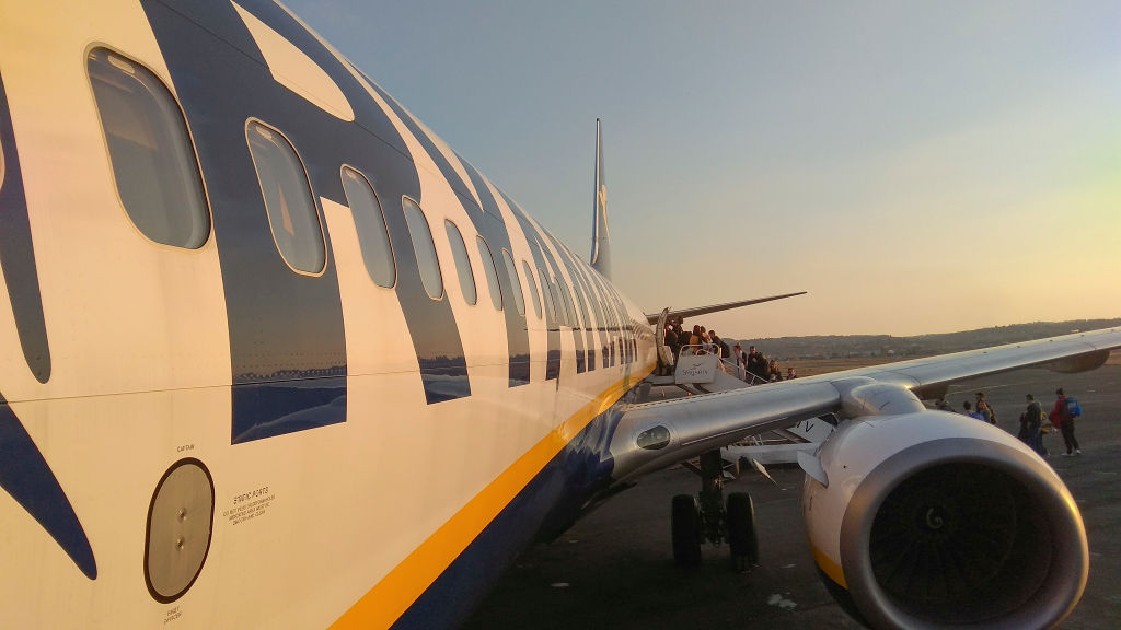 Passengers Boarding On Ryanair Airplane