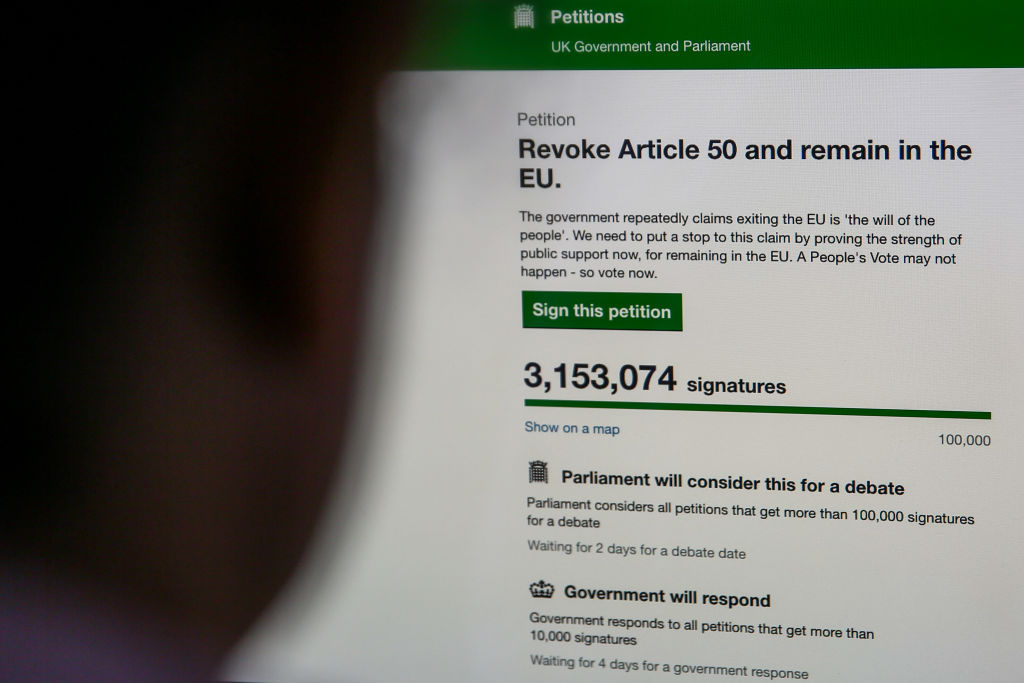 A woman in seen viewing the UK Government's Petition website