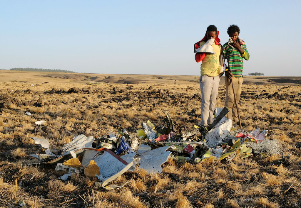 Workers Attend The Crash Site Of Ethiopian Airlines ET302 Flight To Nairobi