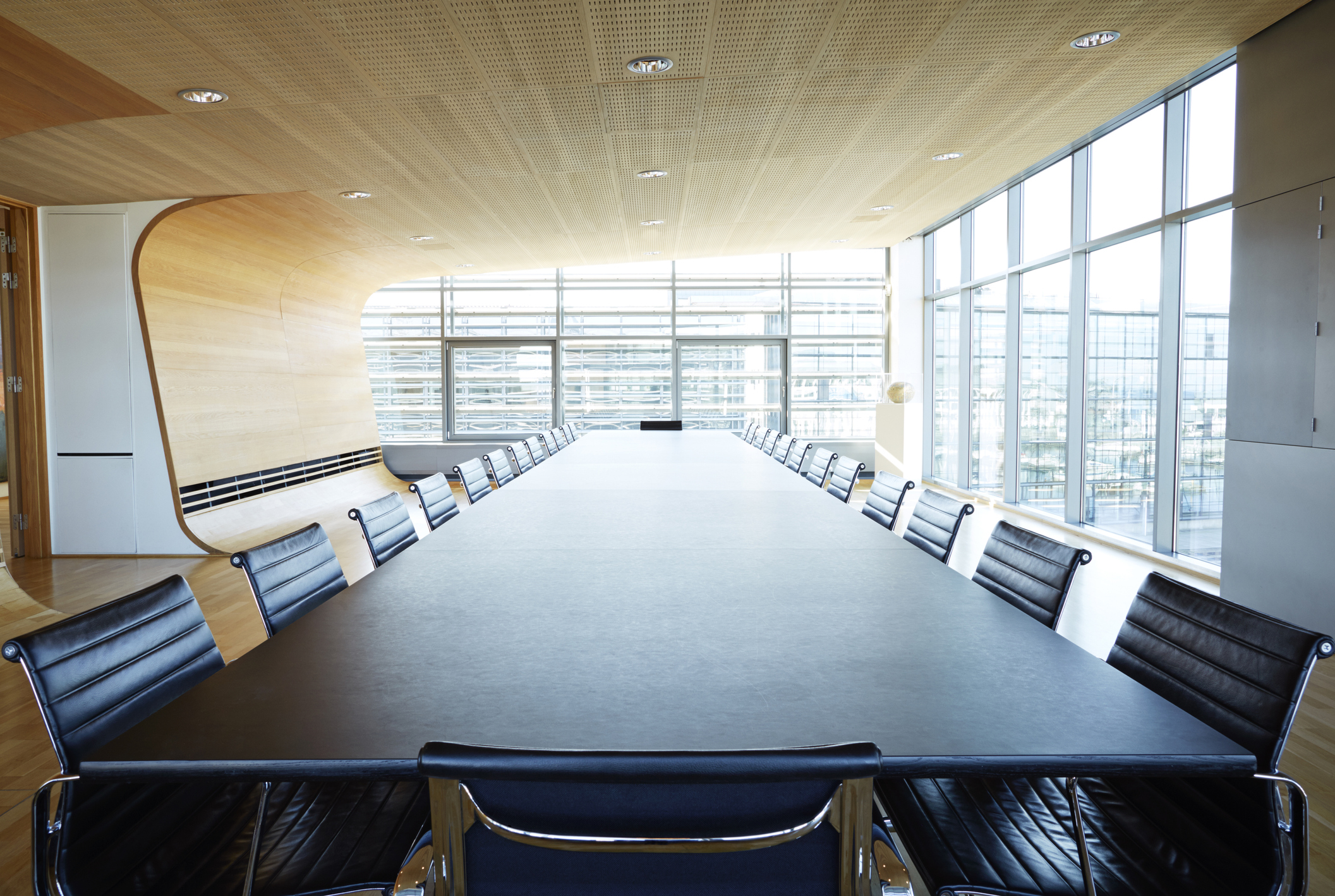 View over huge table in designed meeting room