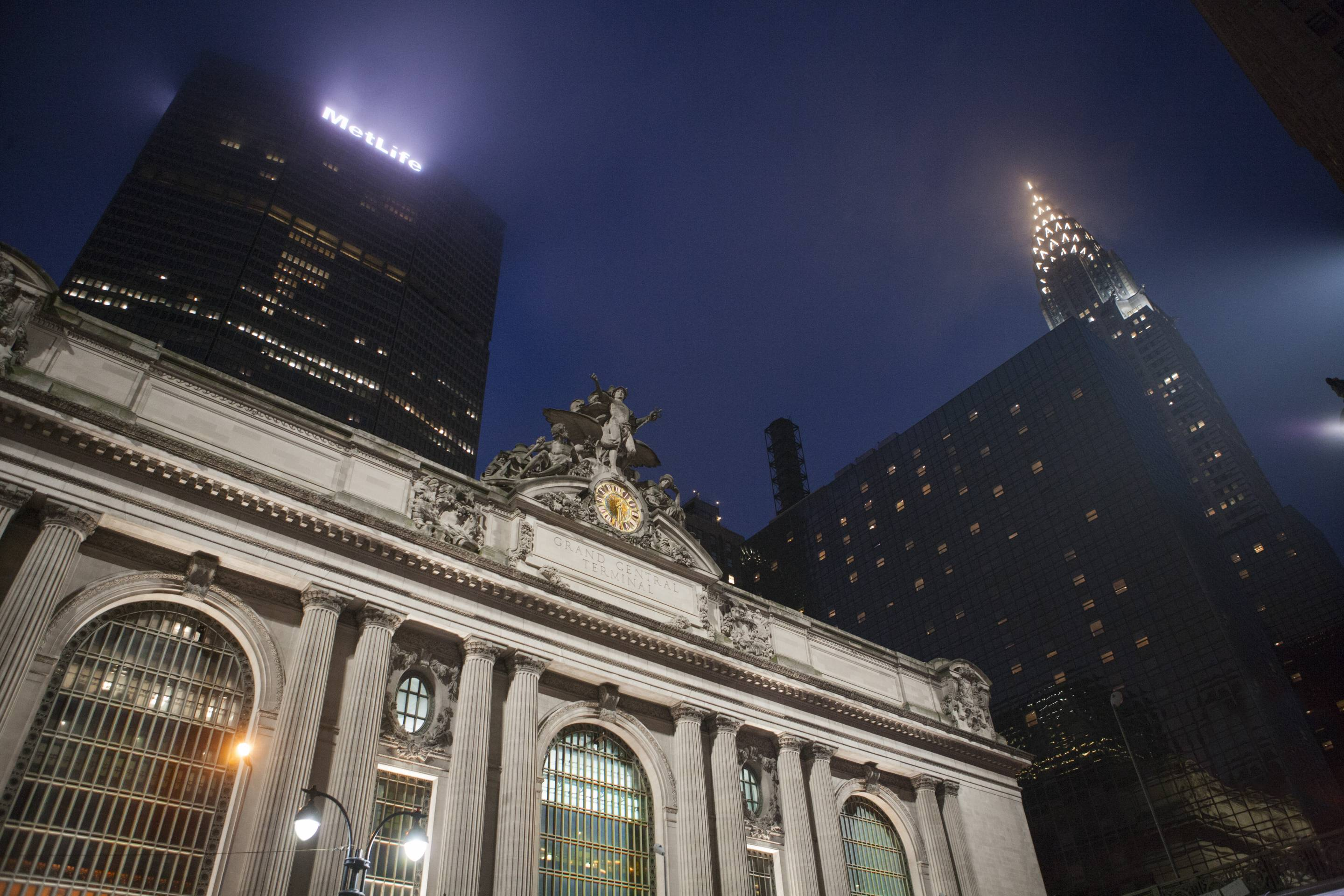 Low Angle View of Grand Central Terminal at Night, Met Life and Chrysler Buildings in Background, New York City, New York, USA
