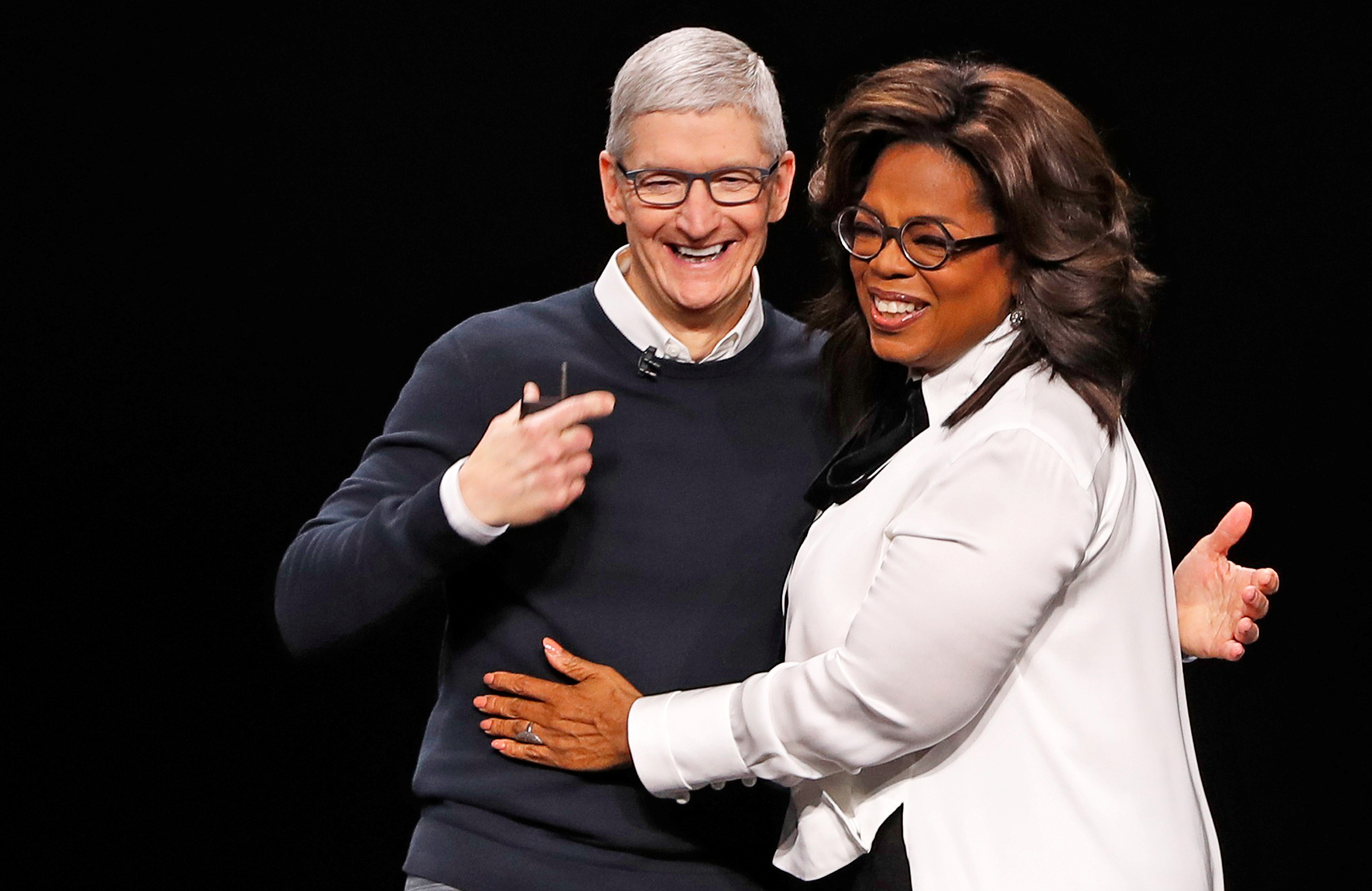 Tim Cook, CEO of Apple and Oprah Winfrey hug during an Apple special event at the Steve Jobs Theater in Cupertino