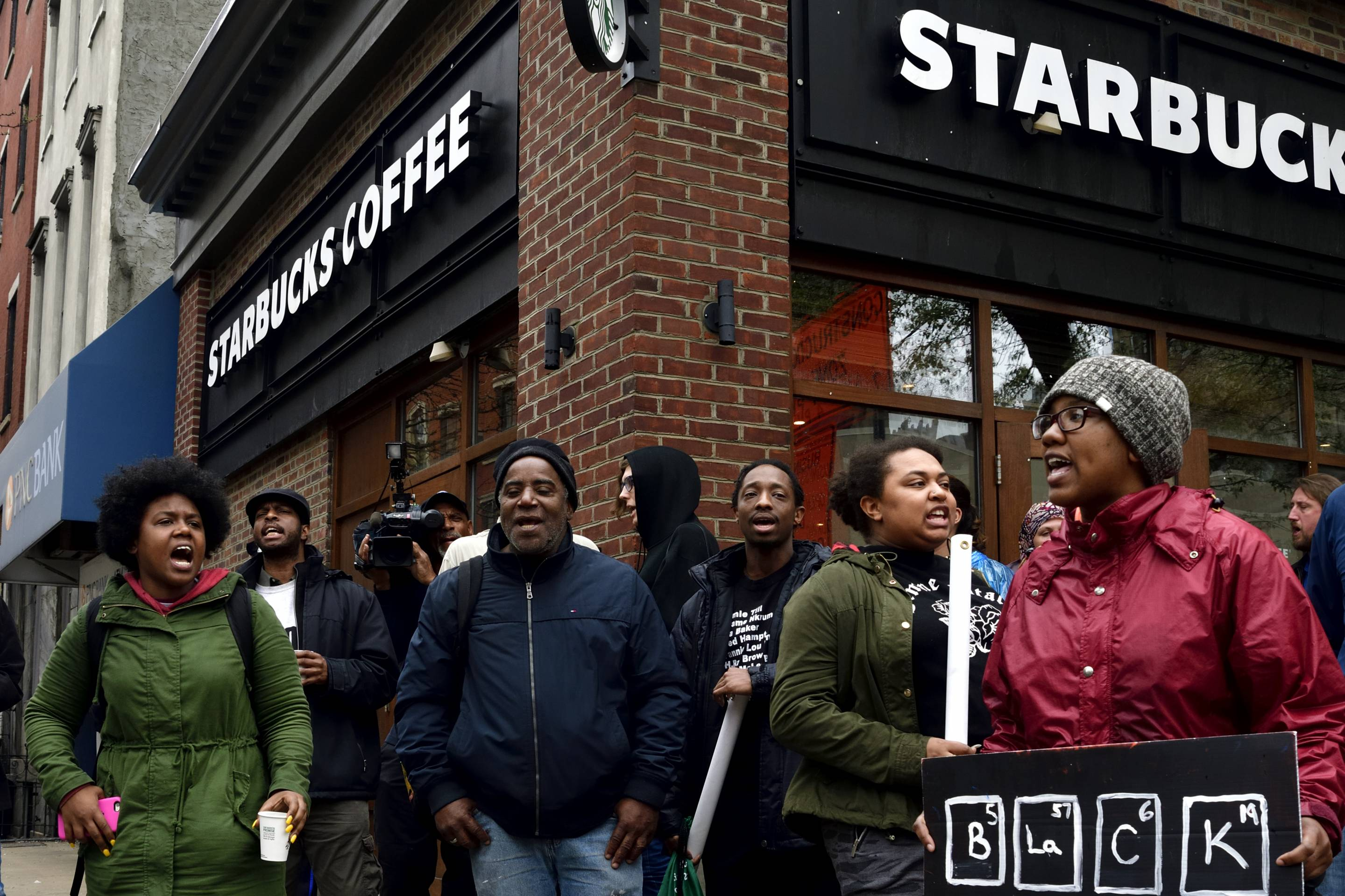 People gather on April 16, 2018 to protest at a Starbucks in Philadelphia, where days earlier two black men were arrested.