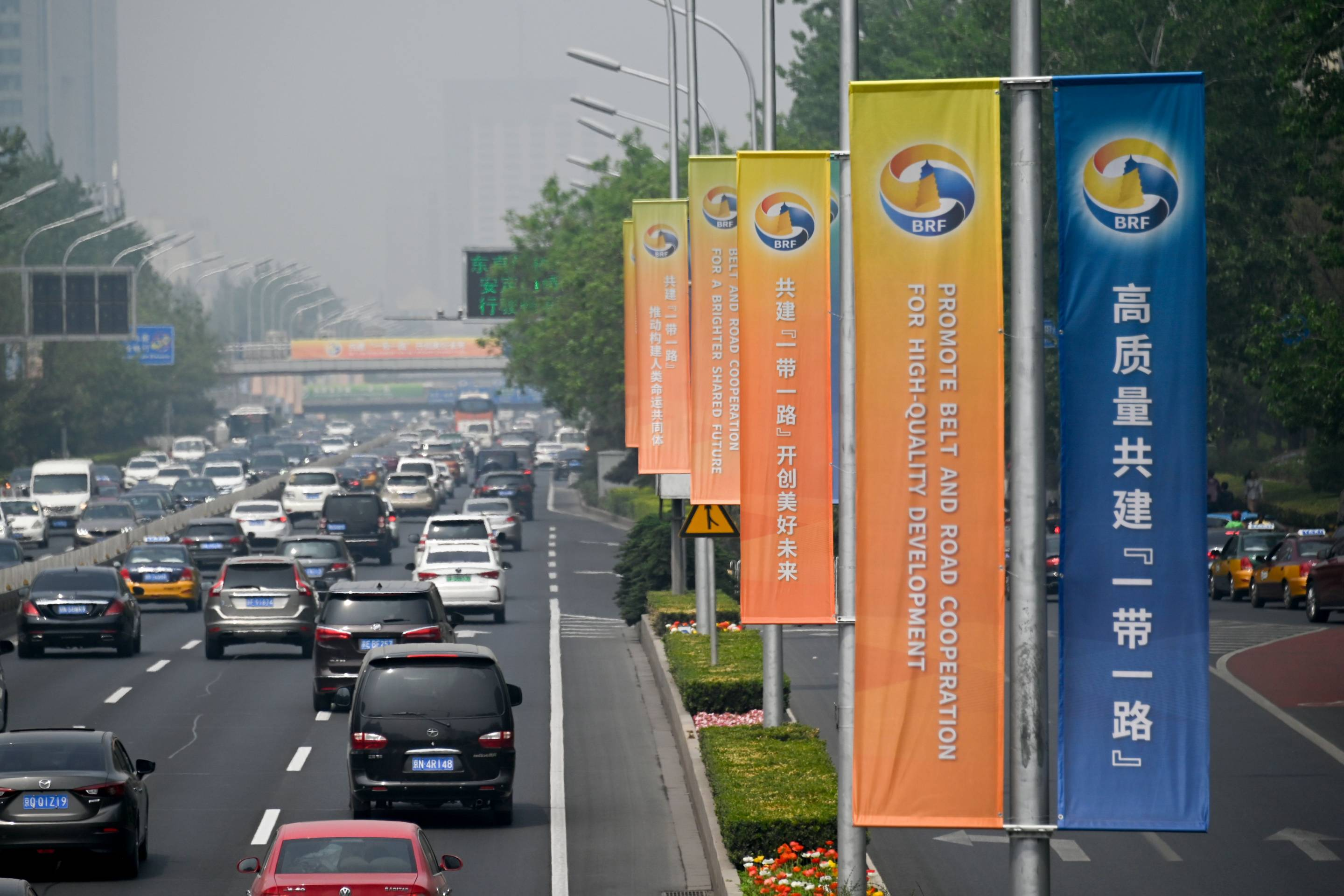 Banners are displayed along a street ahead of the Belt and Road Forum in Beijing on April 22, 2019.