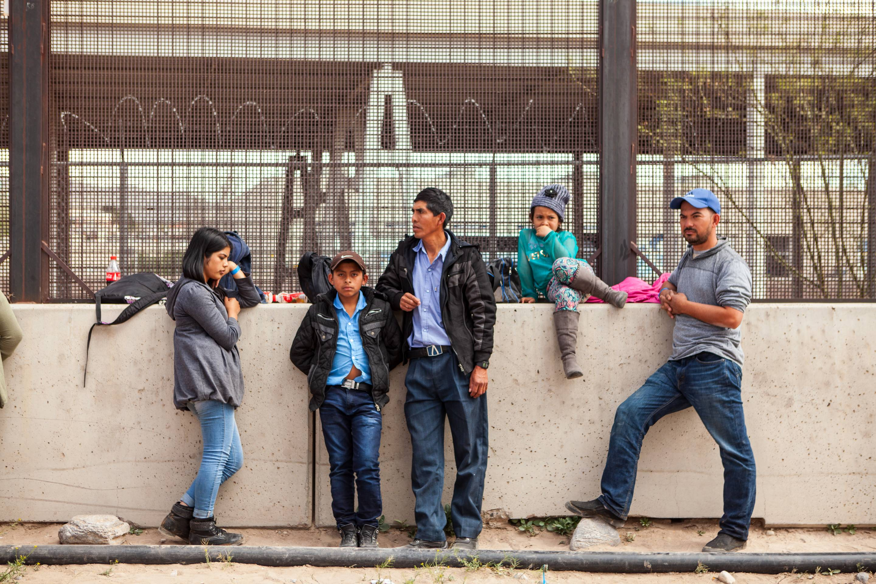 U.S. Customs And Border Protection Agency Holding Detained Migrants Under Bridge In El Paso