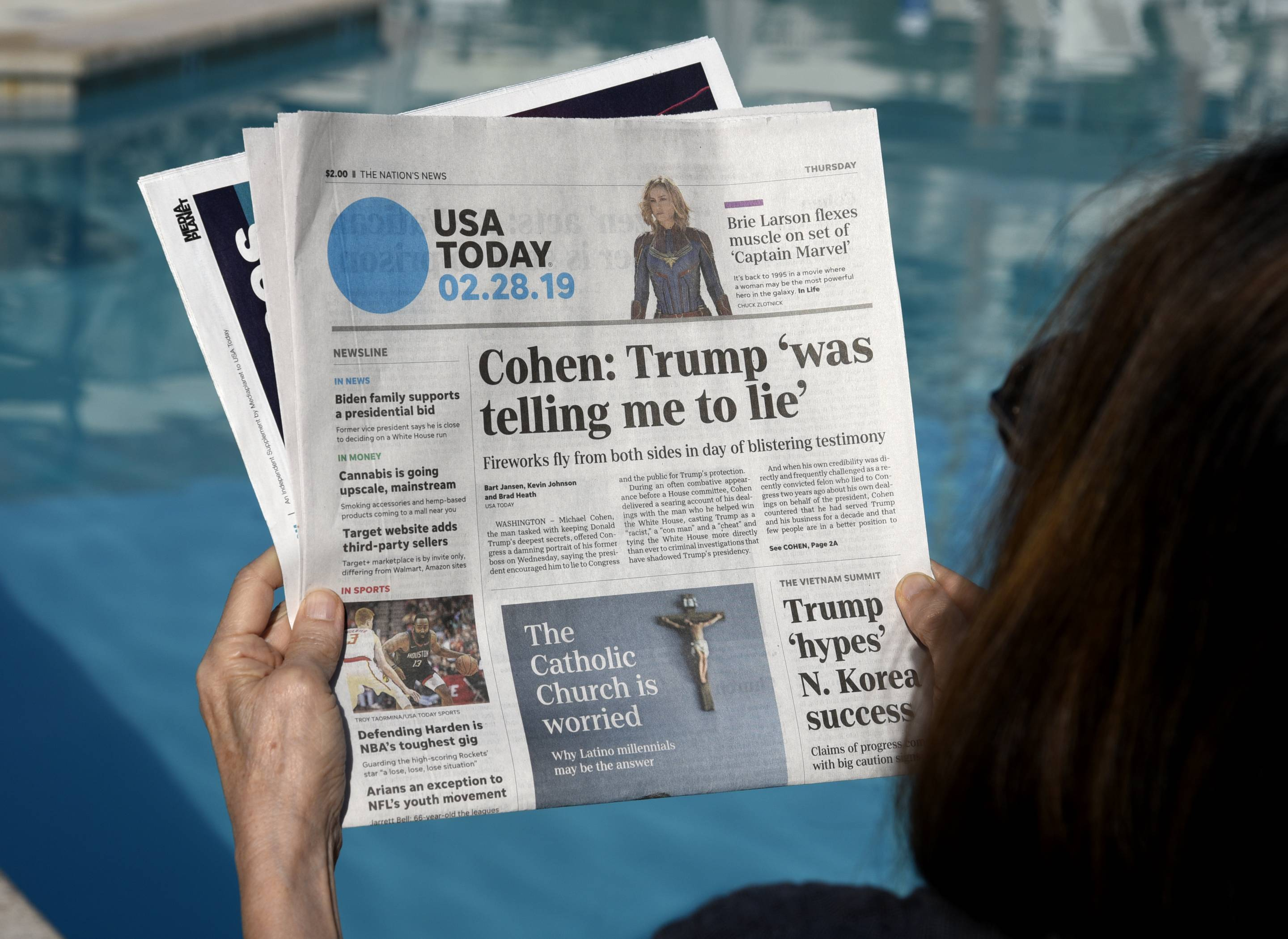 woman reading USA Today newspaper