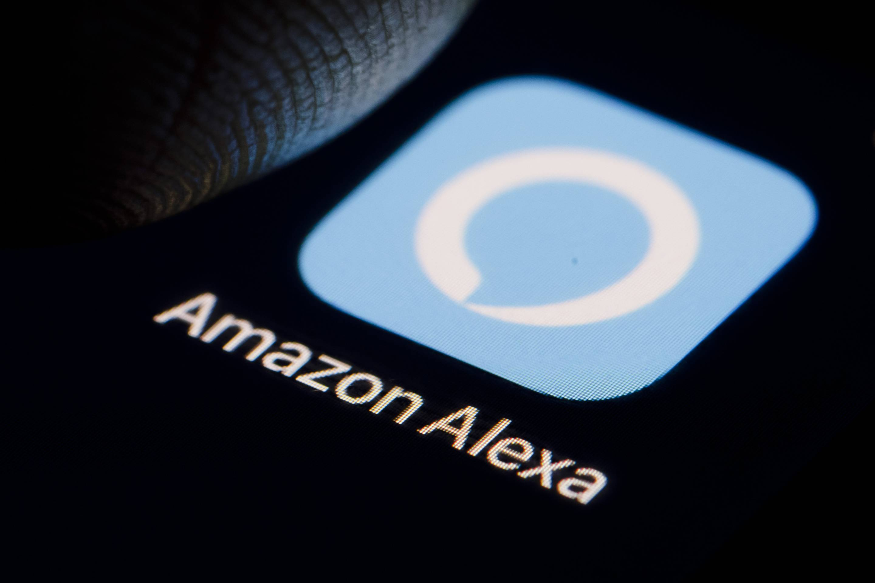 The logo of virtual assistant Amazon Alexa is displayed on a smartphone.