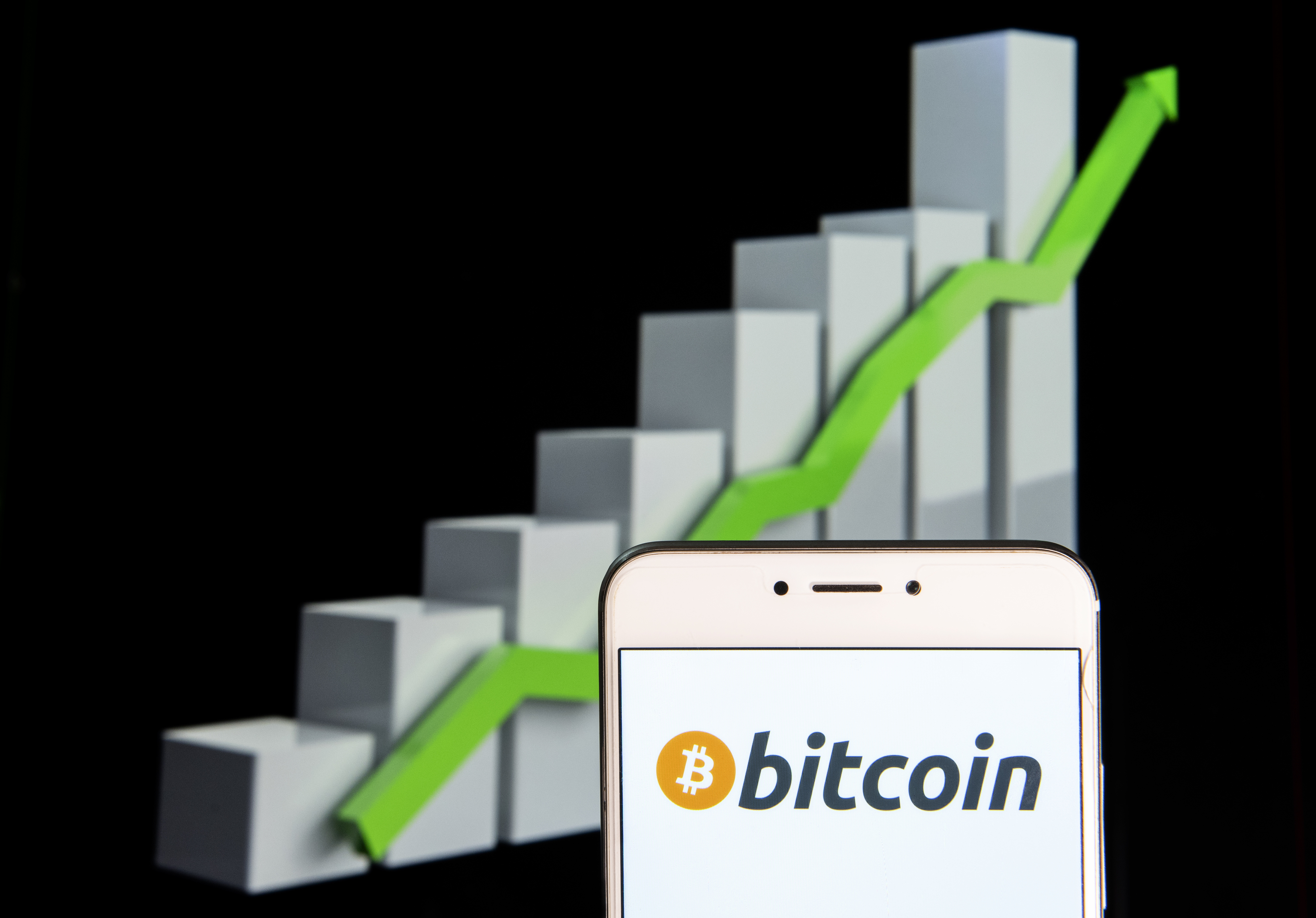 Cryptocurrency electronic cash Bitcoin logo is seen on a phone
