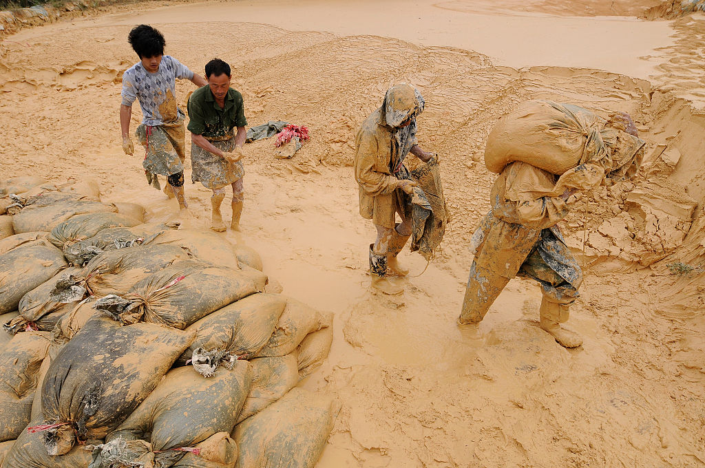 Labourers work at the site of a rare earth metals mine at Nancheng county, Jiangxi province