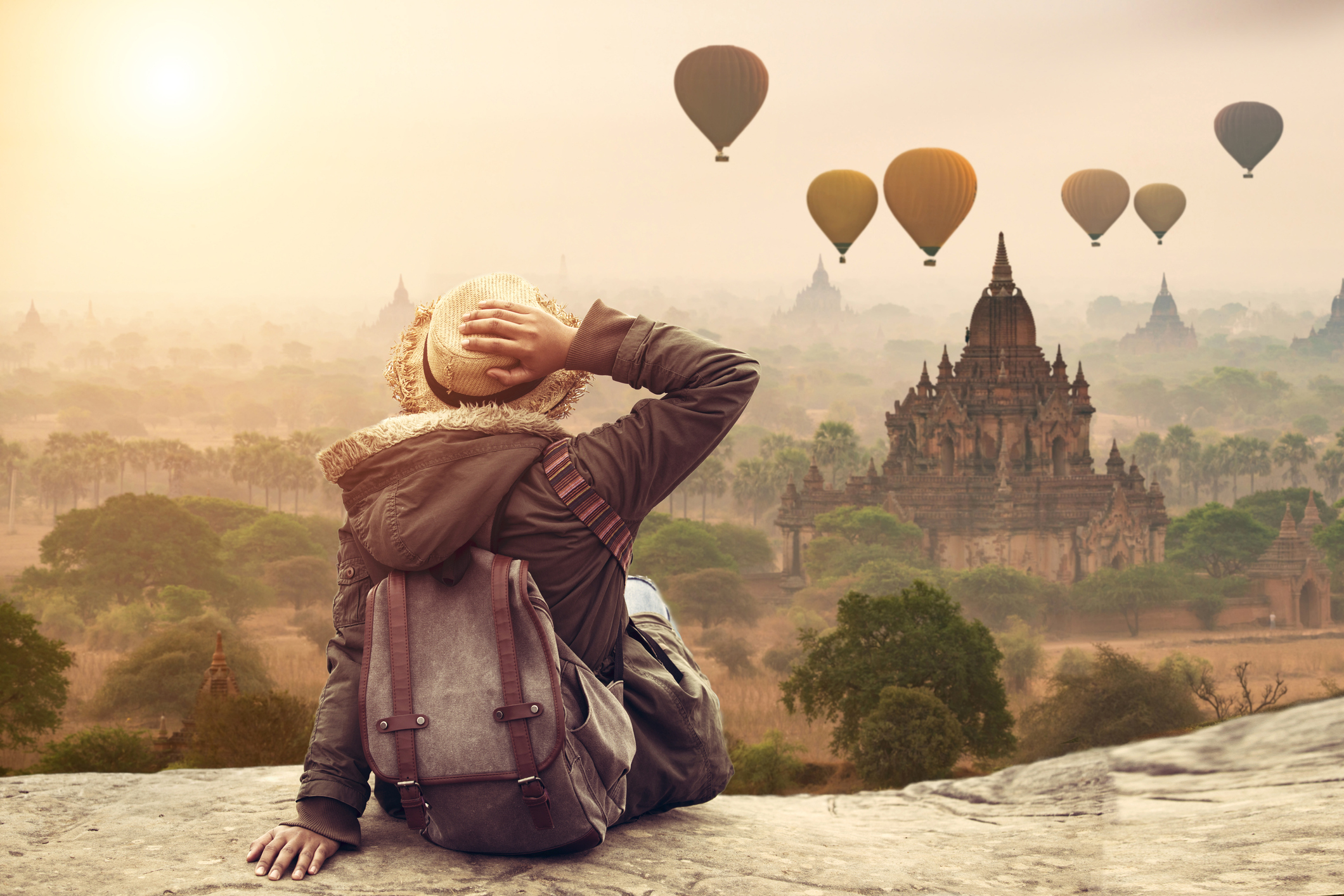 Myanmar, Young hipster woman traveller backpacker sitting watch Beautiful landscape Bagan Mandalay ancient pagoda in Bagan, Mandalay Myanmar.