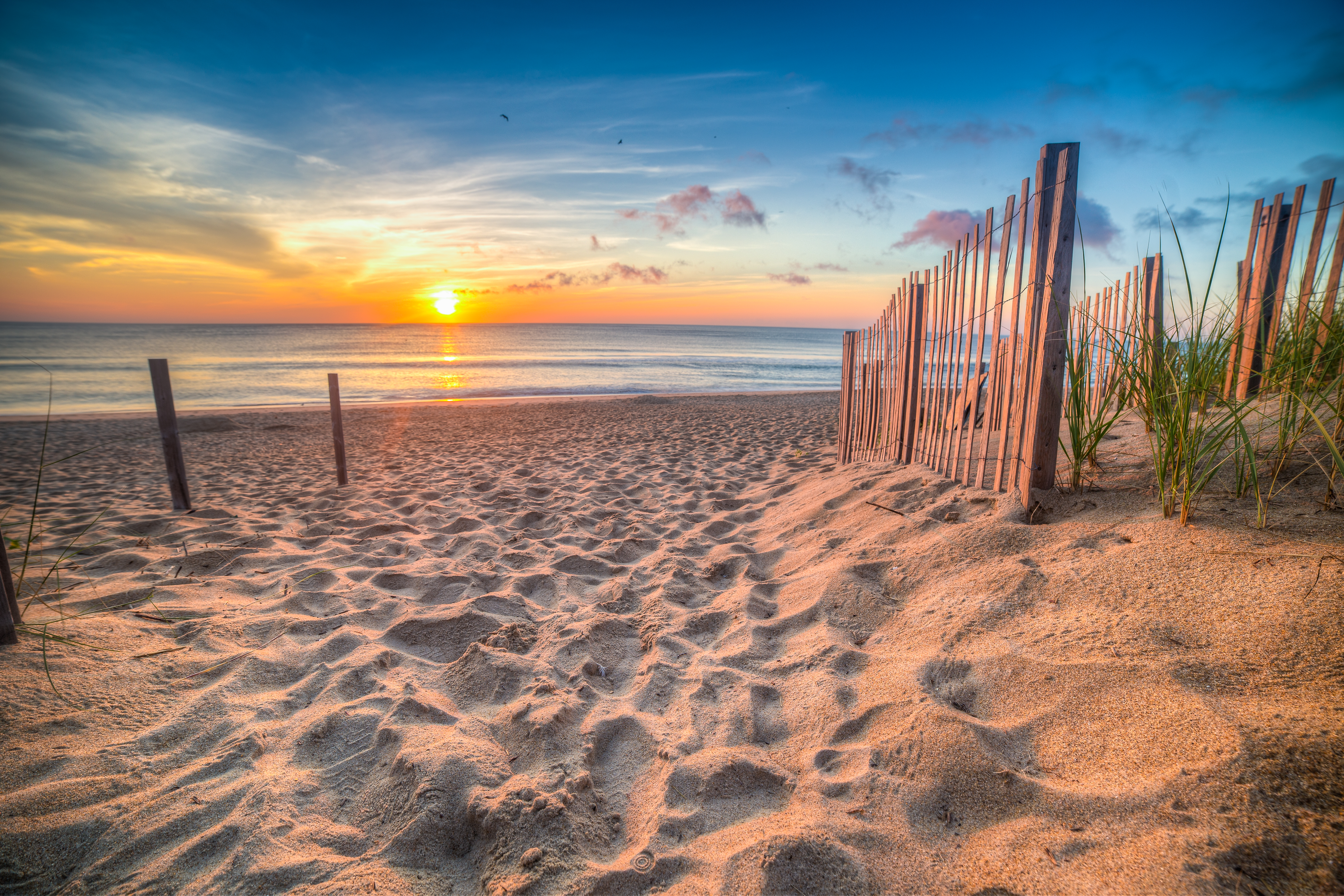 Sandy beach and Atlantic Ocean at sunrise, Outer Banks, North Carolina, USA