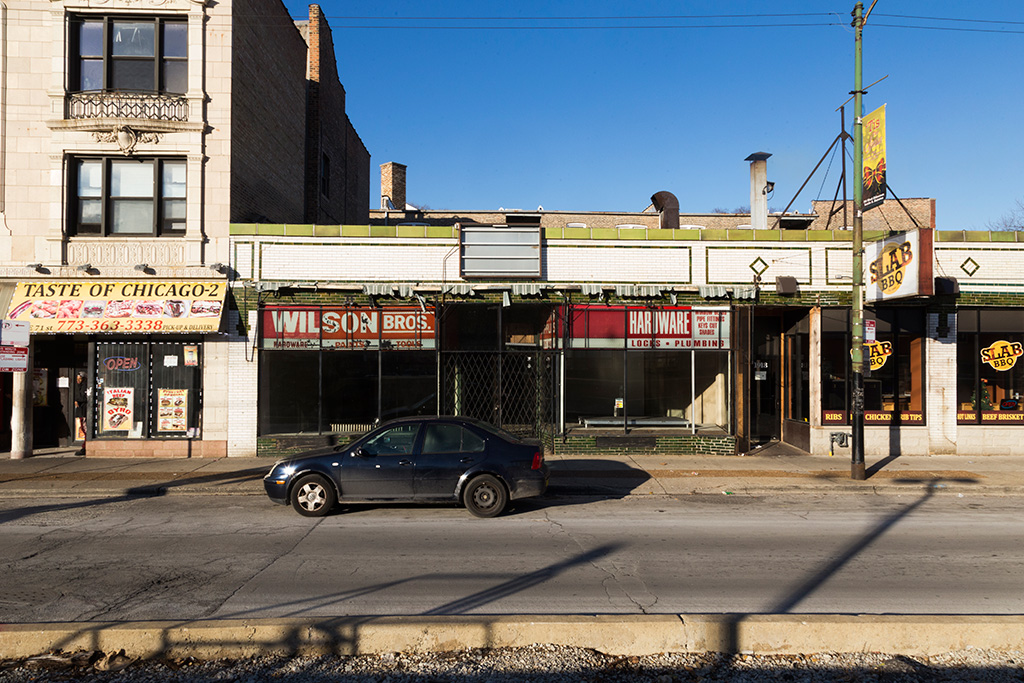 A shuttered storefront, once home to Wilson Brothers Paint and Hardware Company, on 71st Street in Chicago's South Shore neighborhood.