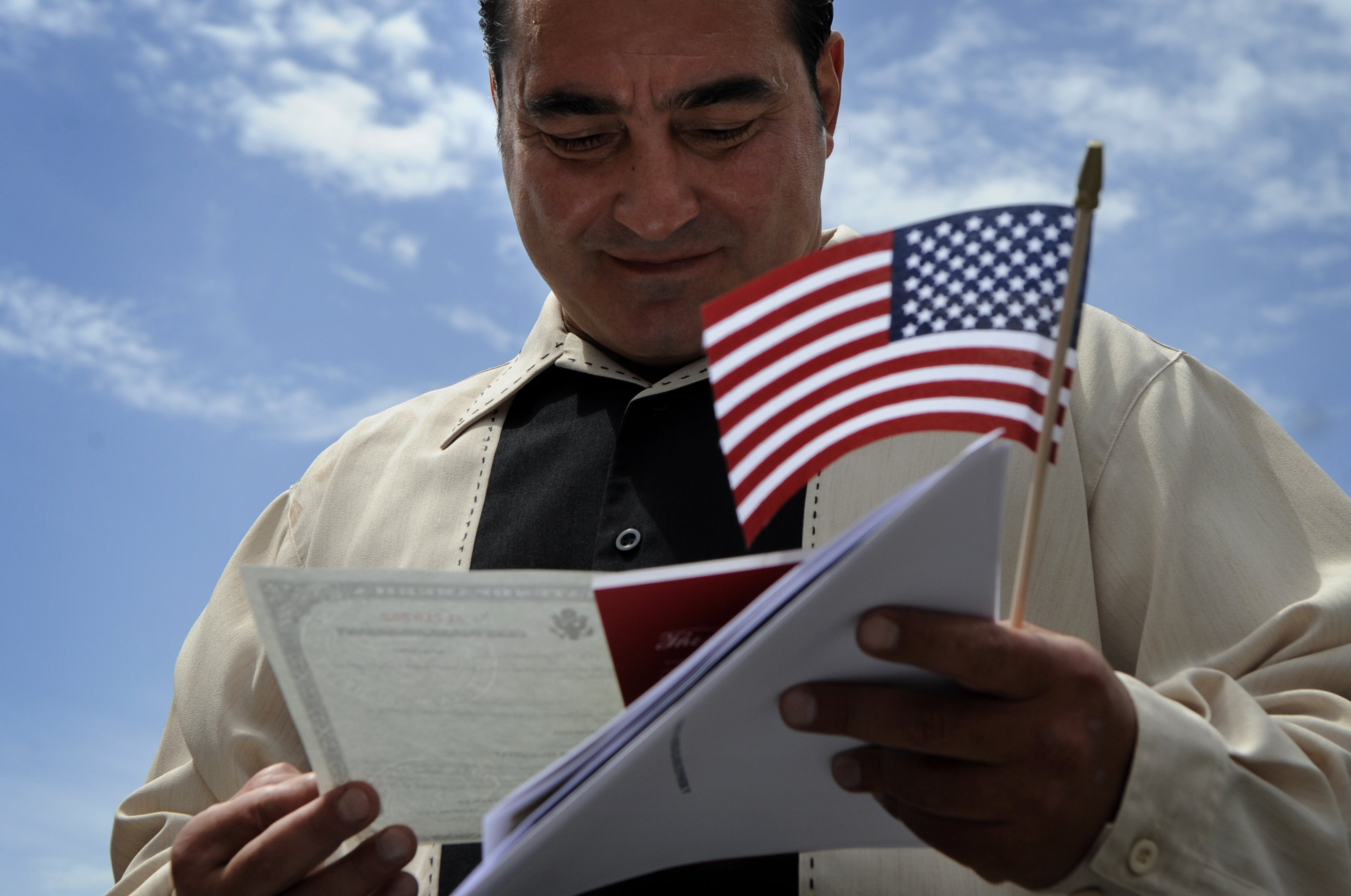 (XX)WRESTLER_062308_CFW- Tsolak Yeghishyan admires his Certificate of Naturalization after his naturalization ceremony at the United States Citizenship & Immigration Services building in Denver, CO. Tsolak Yeghishyan was an Olympic wrestler for Armenia in