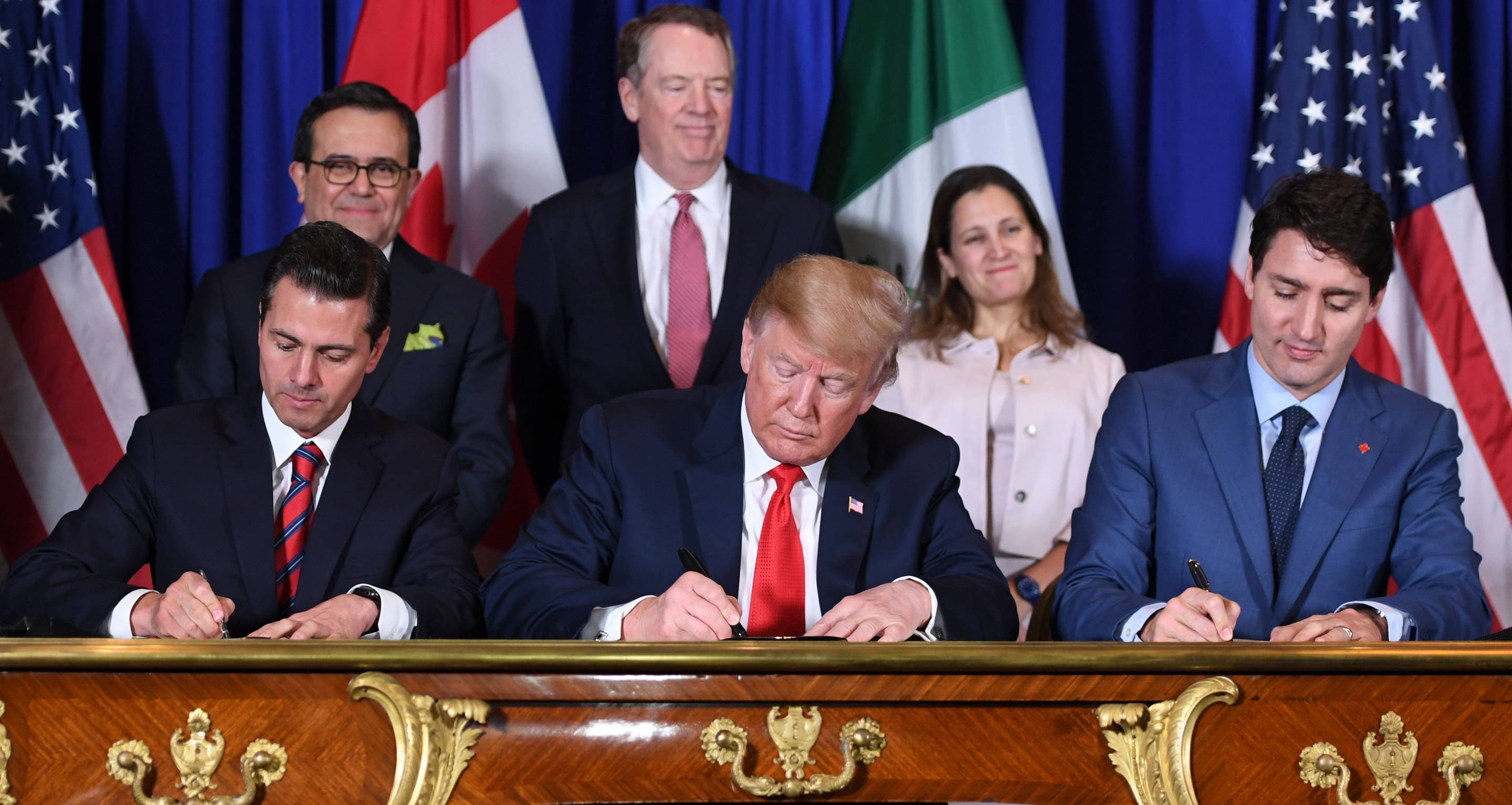 Mexico's President Enrique Pena Nieto (L), U.S. President Donald Trump (C), and Canadian Prime Minister Justin Trudeau sign the US-Mexico-Canada Agreement (USMCA)