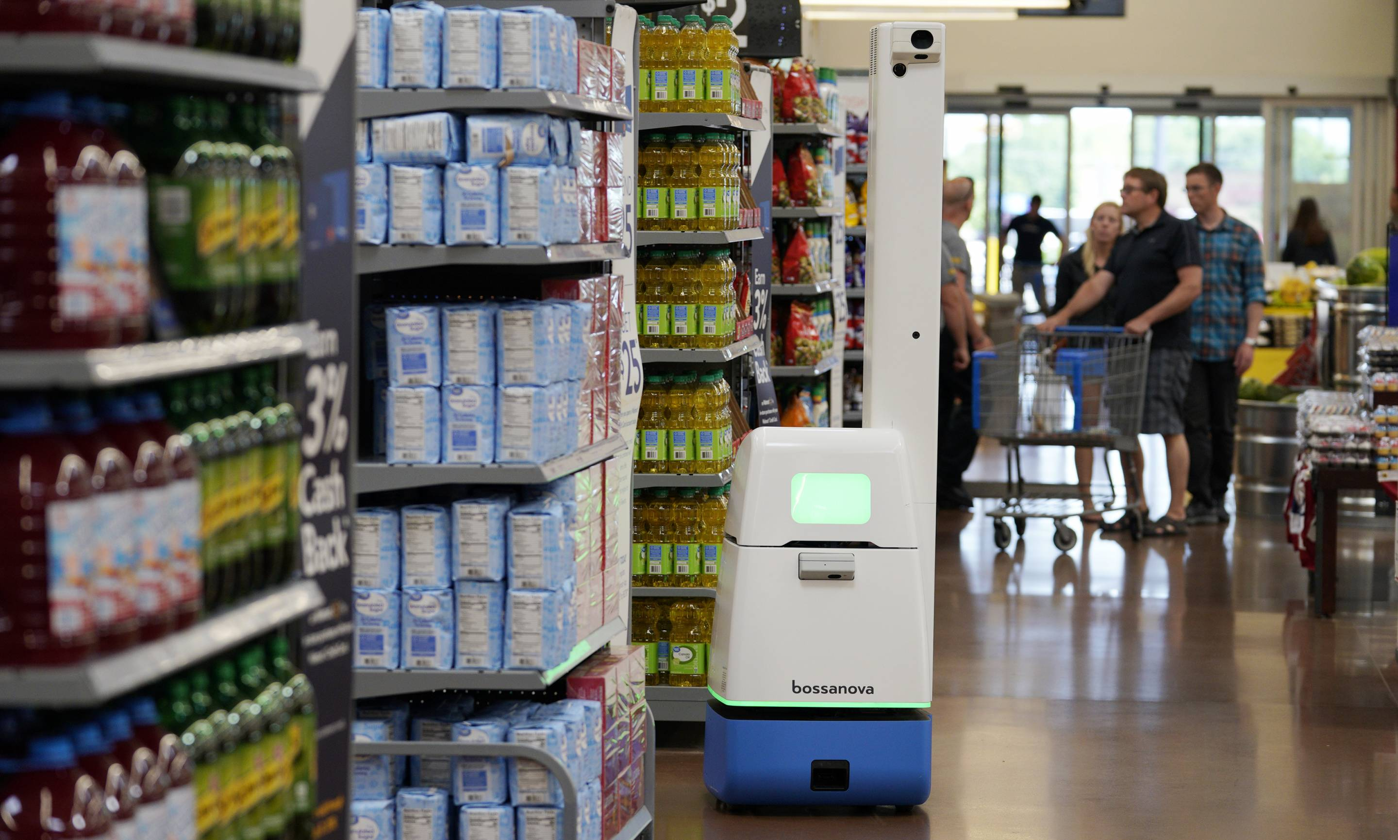 A Bossa Nova Robotics scanning device moves through an aisle at a Walmart Supercenter during the company's annual shareholders meeting on May 31, 2018 in Rogers, Ark.