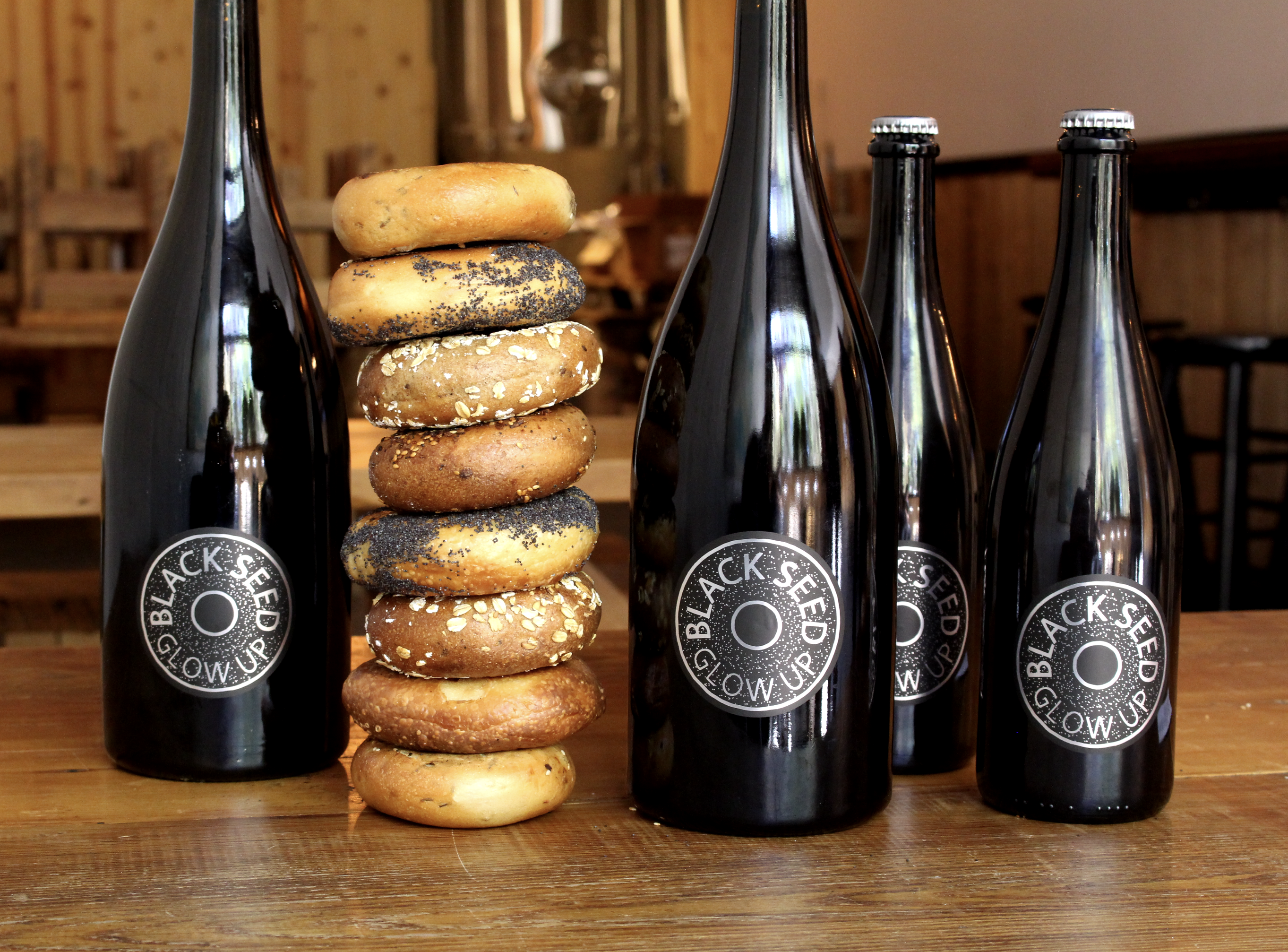 Two Brooklyn-based businesses have partnered to create Black Seed Glow Up, a limited-release beer brewed by Folksbier using Black Seed's leftover bagels.
