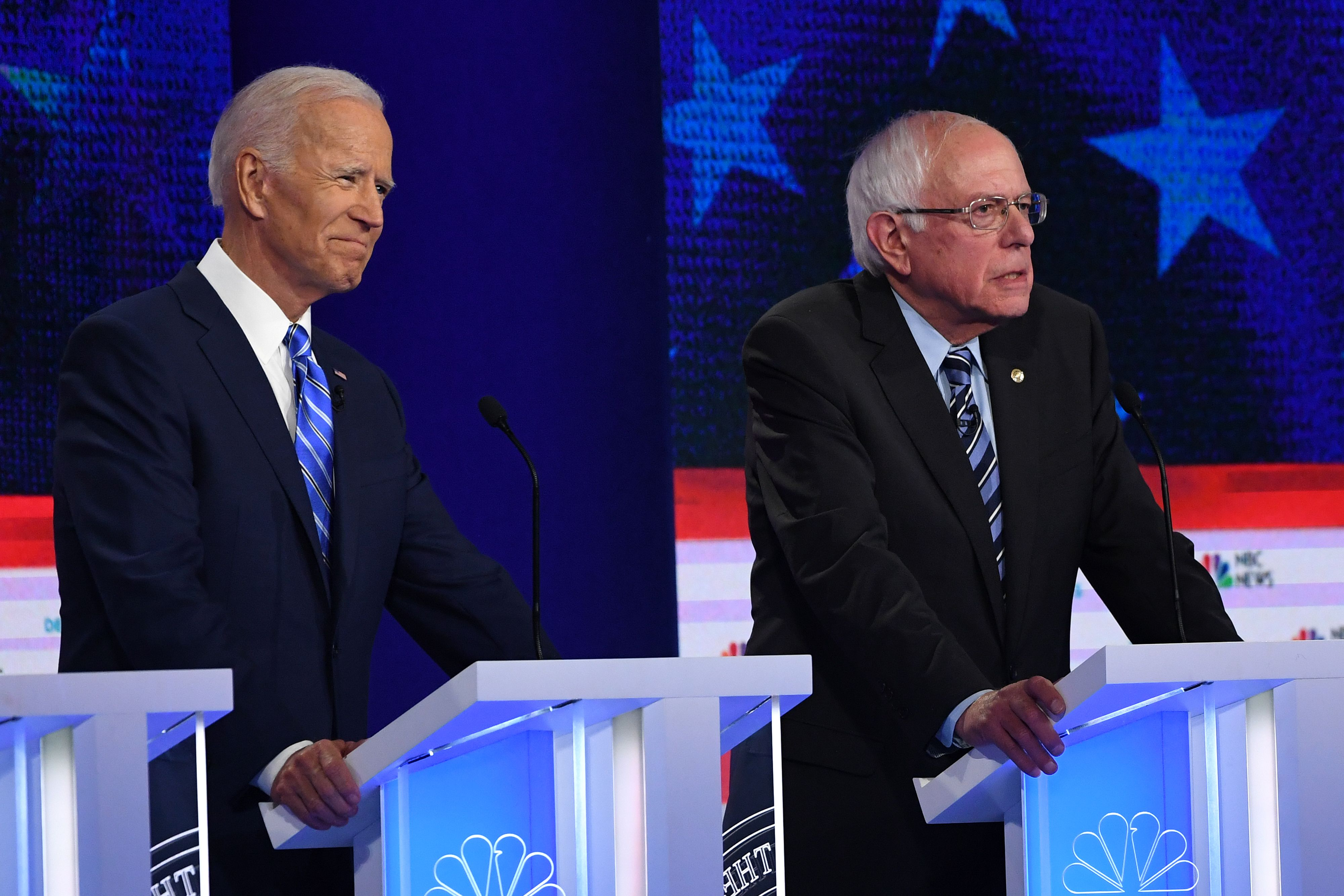 Democratic presidential hopefuls (fromL) former US Vice President Joseph R. Biden Jr. and US Senator for Vermont Bernie Sanders participate in the second Democratic primary debate of the 2020 presidential campaign season hosted by NBC News at the Adrienne Arsht Center for the Performing Arts in Miami, Florida, June 27, 2019.