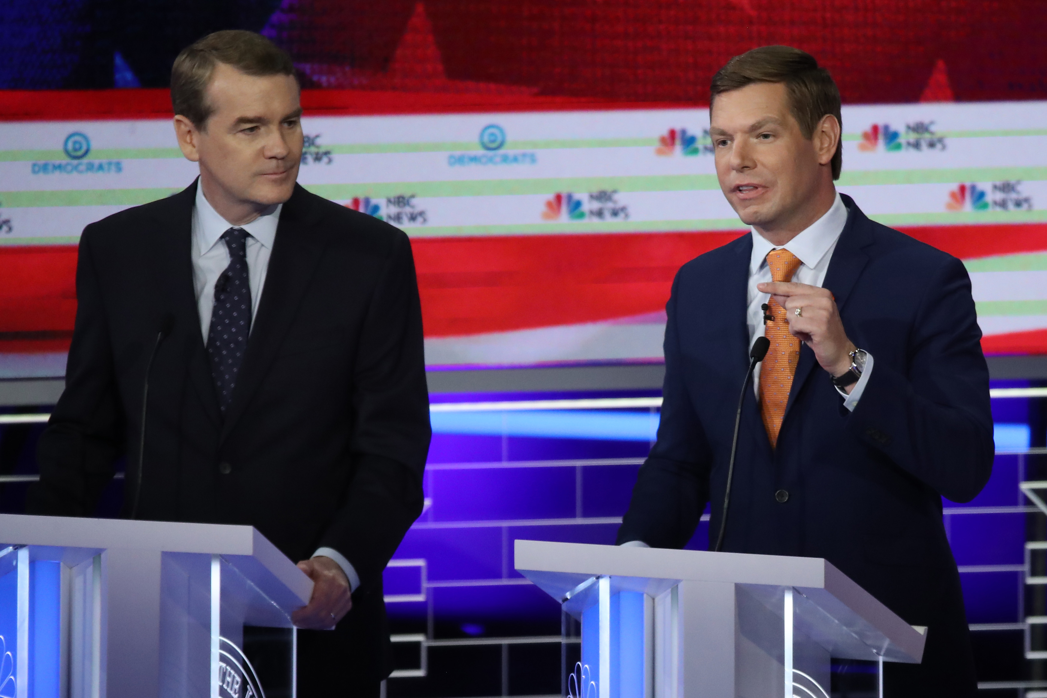 Rep. Eric Swalwell (D-CA) speaks as Sen. Michael Bennet (D-CO) looks on during the second night of the first Democratic presidential debate on June 27, 2019 in Miami, Florida.