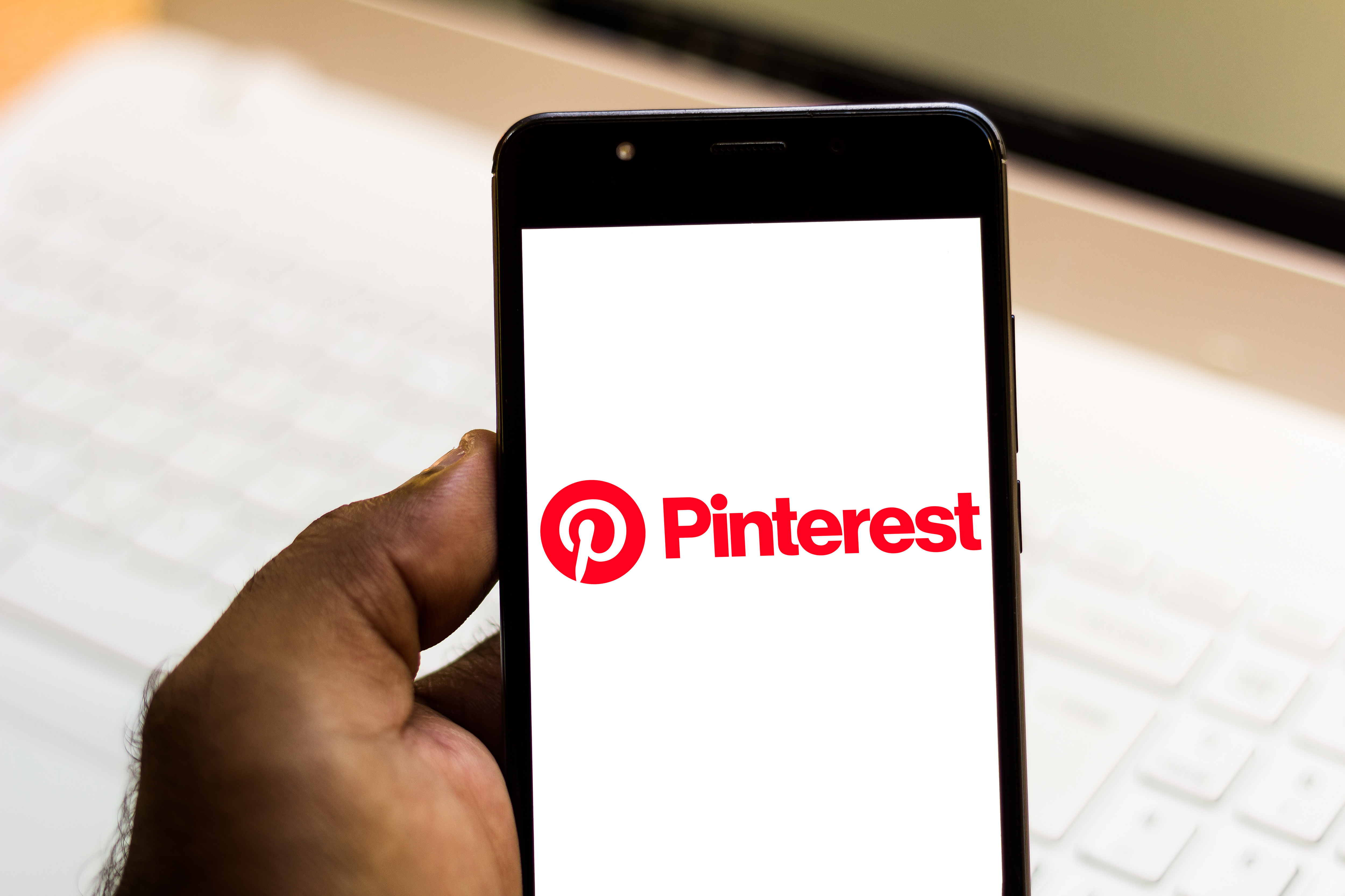 In this photo illustration the Pinterest logo is seen
