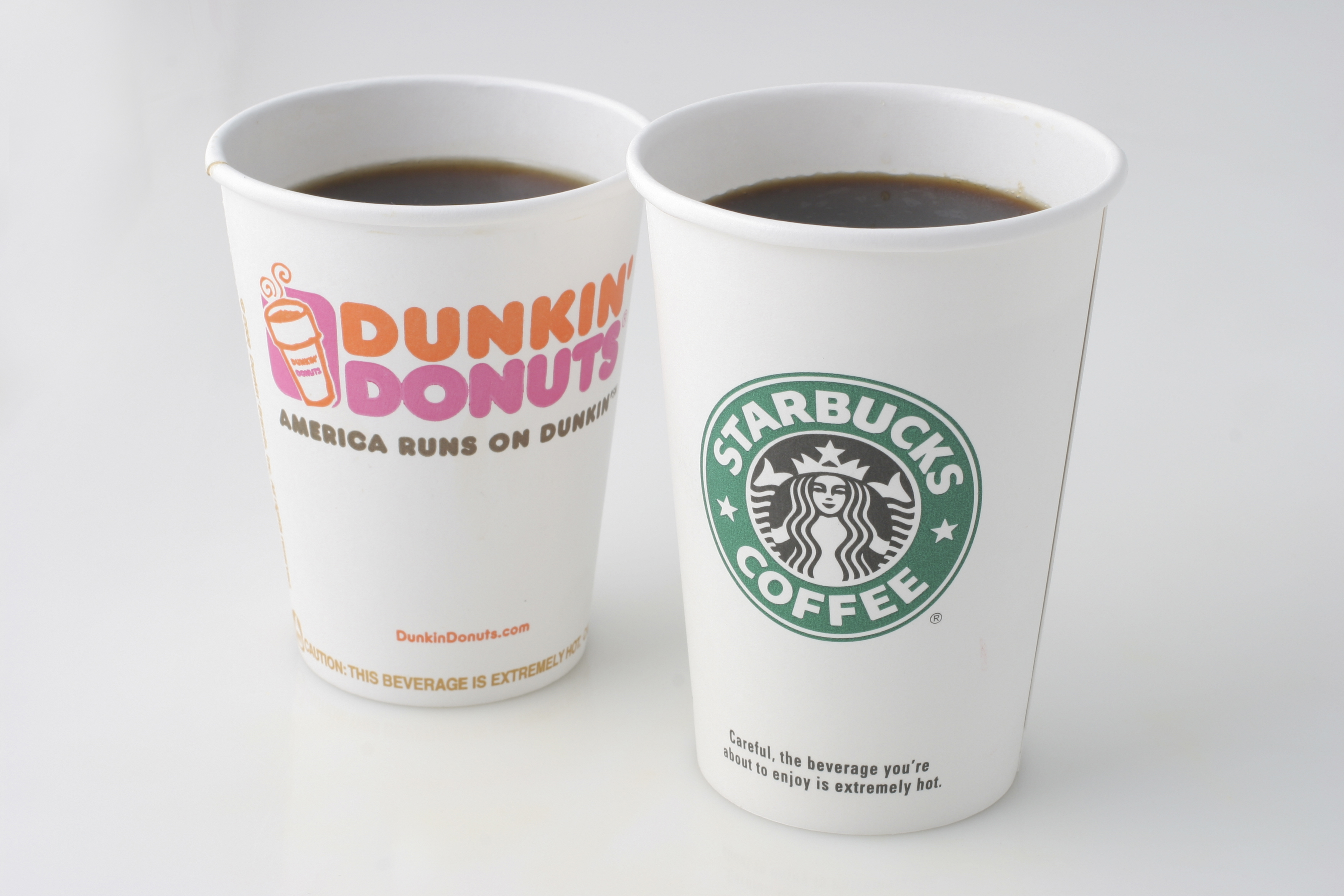 Dunkin' Donuts and Starbucks coffee cups