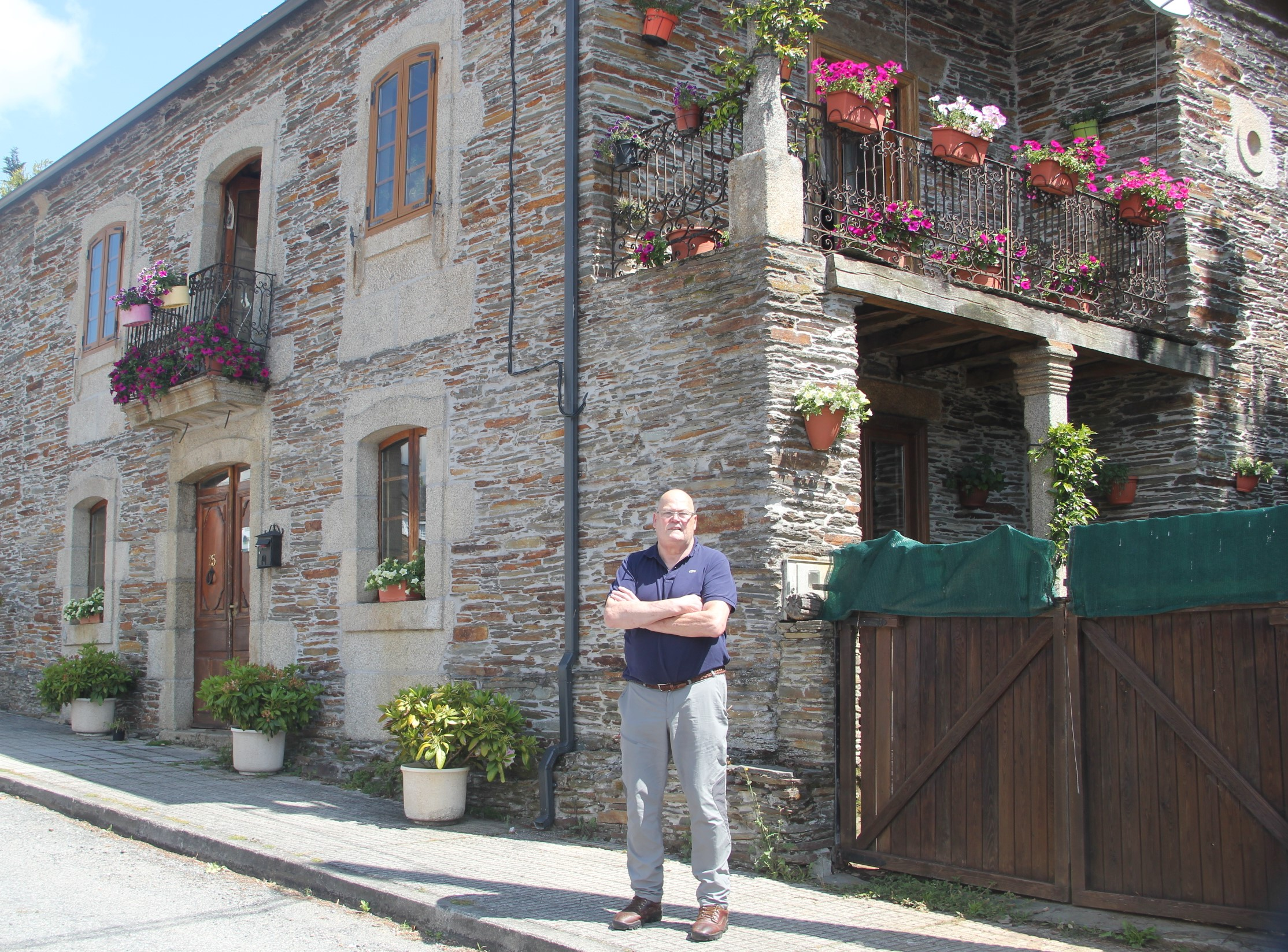 Mark Adkinson outside his renovated home in Lugo, Spain