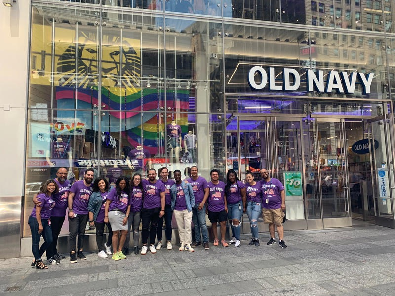 Old Navy employees in front of a store in Times Square in New York City.