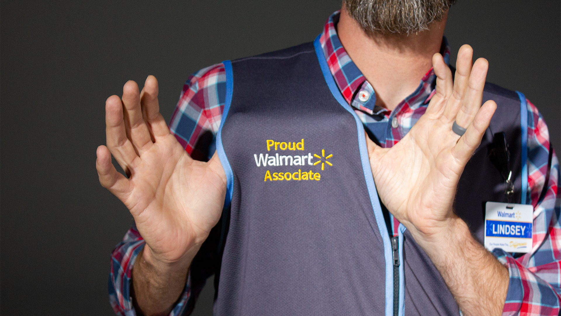 Walmart is redesigning its signature blue vests worn by employees in stores.