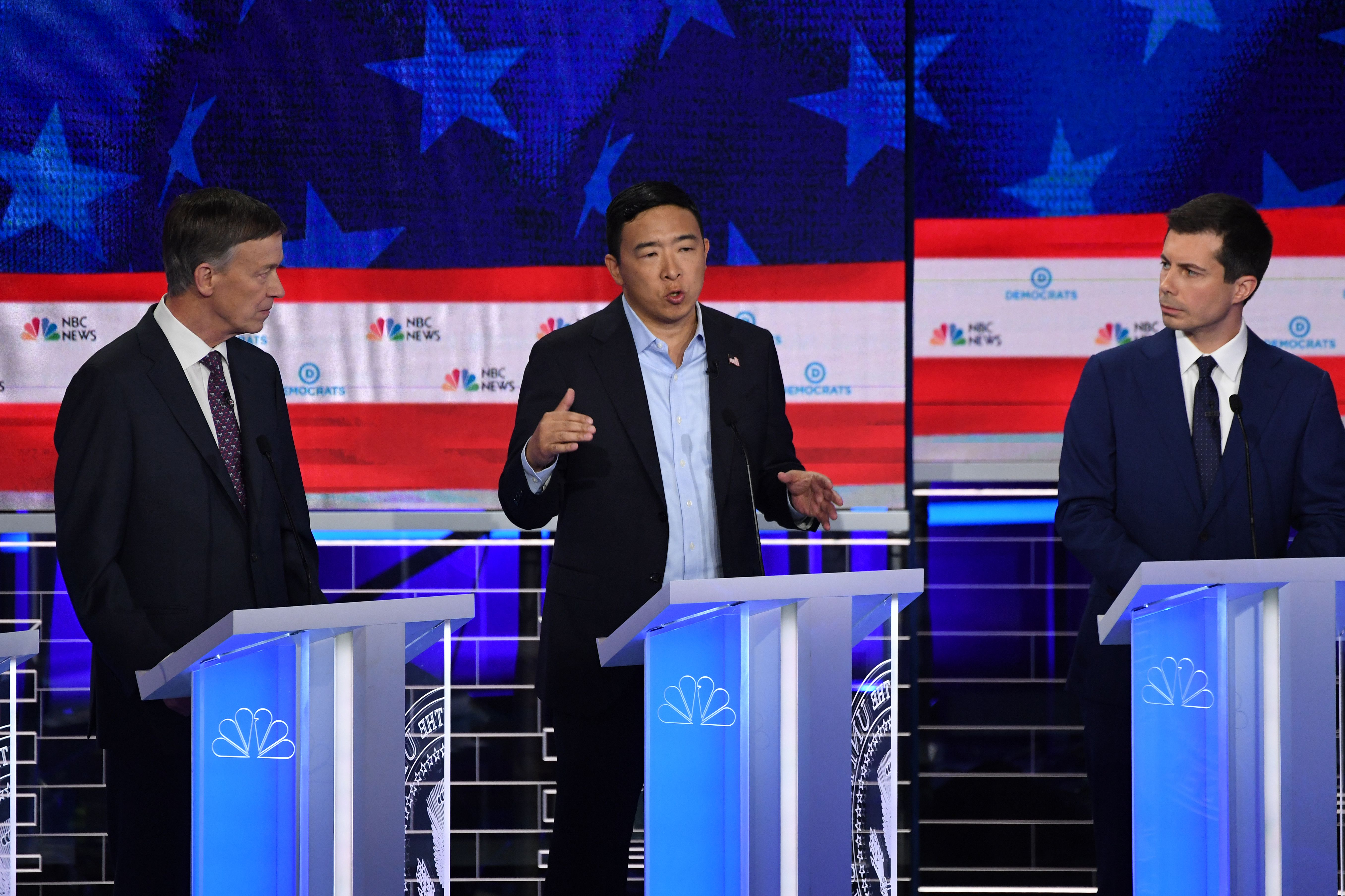 Democratic presidential hopefuls (fromL) former Governor of Colorado John Hickenlooper, US entrepreneur Andrew Yang and Mayor of South Bend, Indiana Pete Buttigieg participate in the second Democratic primary debate of the 2020 presidential campaign season hosted by NBC News at the Adrienne Arsht Center for the Performing Arts in Miami, Florida, June 27, 2019. (Photo by SAUL LOEB / AFP)        (Photo credit should read SAUL LOEB/AFP/Getty Images)