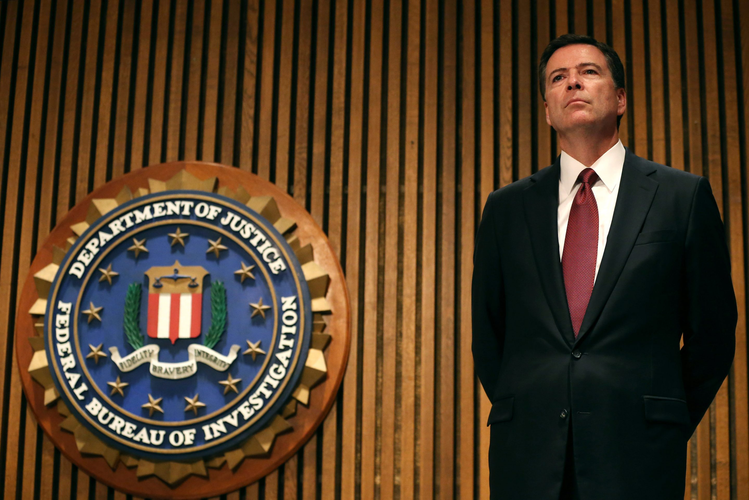 FBI Director James Comey participates in a news conference at FBI headquarters, June 23, 2014, in Washington, D.C.