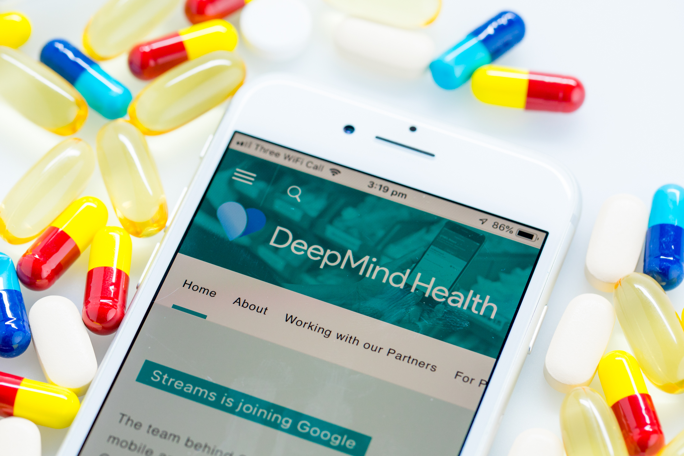 A Deepmind Health webpage sits displayed on the screen of an Apple Inc. iPhone in this arranged photograph in London, U.K. on Monday, Nov. 26, 2018. Three years ago, artificial intelligence company DeepMind Technologies Ltd. embarked on a landmark effort to transform health care in the U.K. Now plans by owner Alphabet Inc. to wrap the partnership into its Google search engine business are tripping alarm bells about privacy.