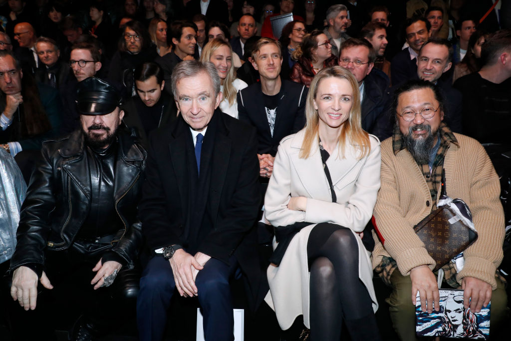 Bernard Arnault, owner of LVMH Luxury Group Bernard Arnault, sits second from left in the front row of a Dior Home menswear show in January 2019.