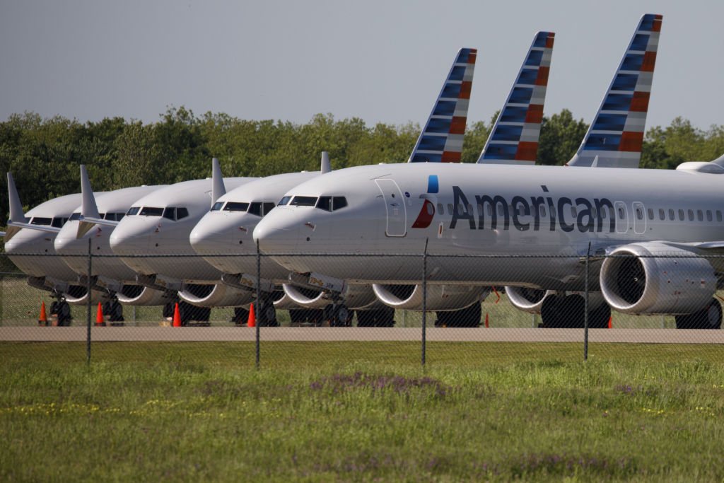 American Airlines Group Inc. Boeing Co. 737 Max planes sit parked outside of a maintenance hangar at Tulsa International Airport. American Airlines said Thursday that the grounding cut profits by $400 million